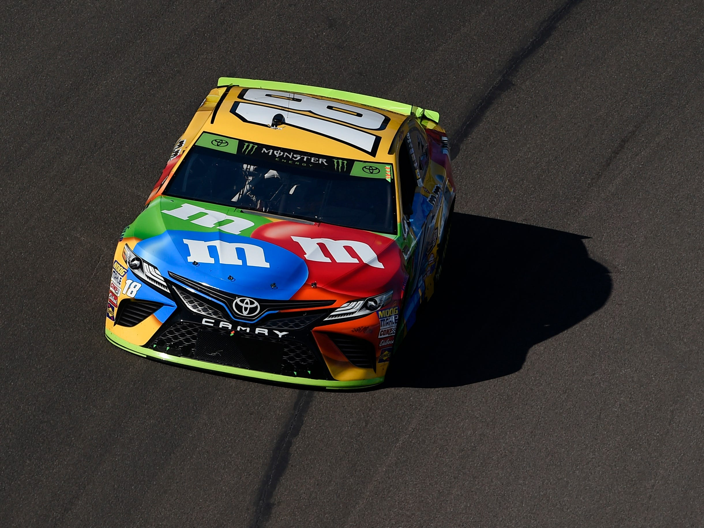 Nov 11, 2018; Avondale, AZ, USA; Monster Energy NASCAR Cup Series driver Kyle Busch (18) during the Can-Am 500 at ISM Raceway. Mandatory Credit: Kelvin Kuo-USA TODAY Sports