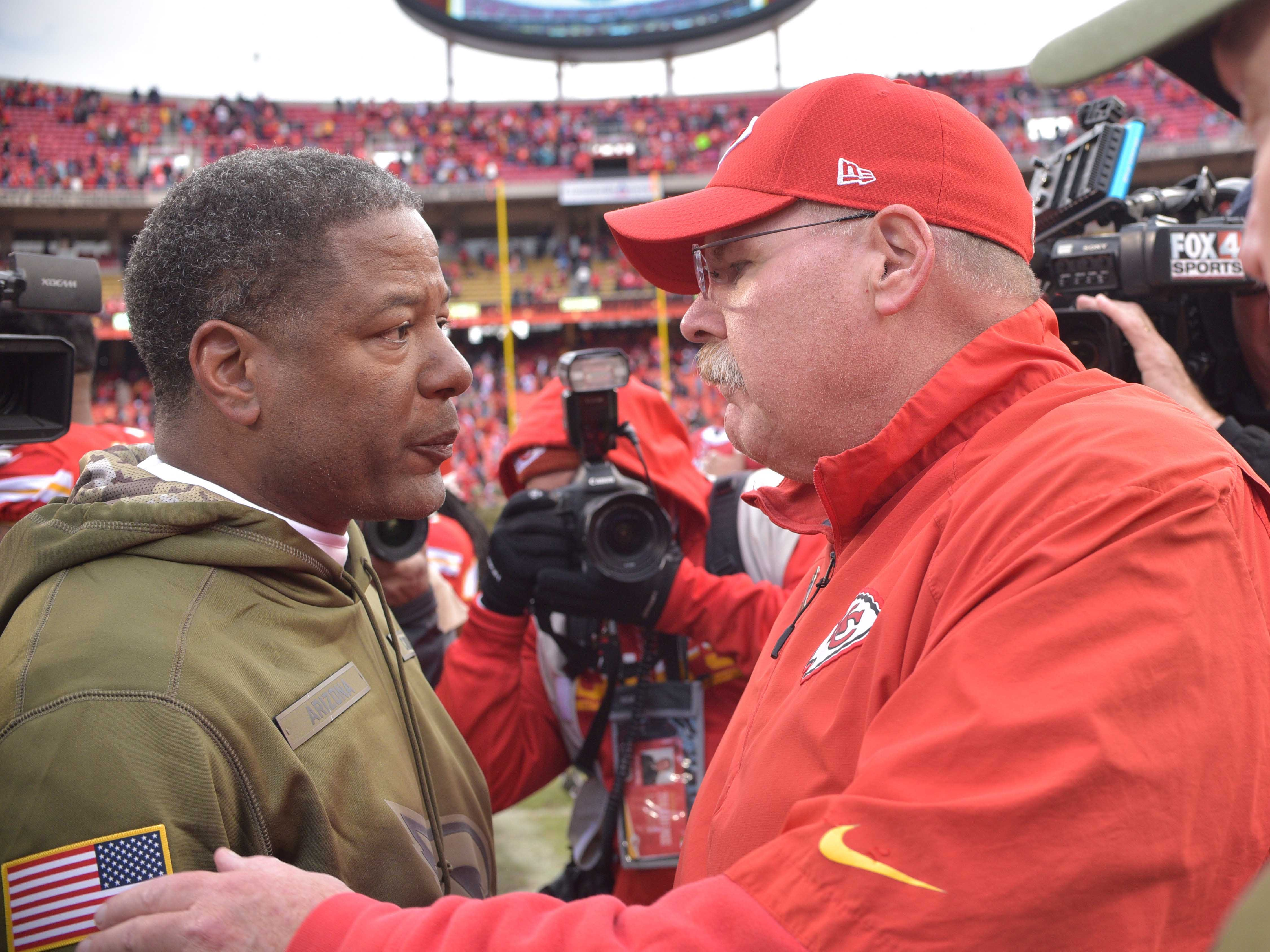 Nov 11, 2018; Kansas City, MO, USA; Arizona Cardinals head coach Steve Wilks congratulates Kansas City Chiefs head coach Andy Reid after the game at Arrowhead Stadium. The Chiefs won 26-14. Mandatory Credit: Denny Medley-USA TODAY Sports