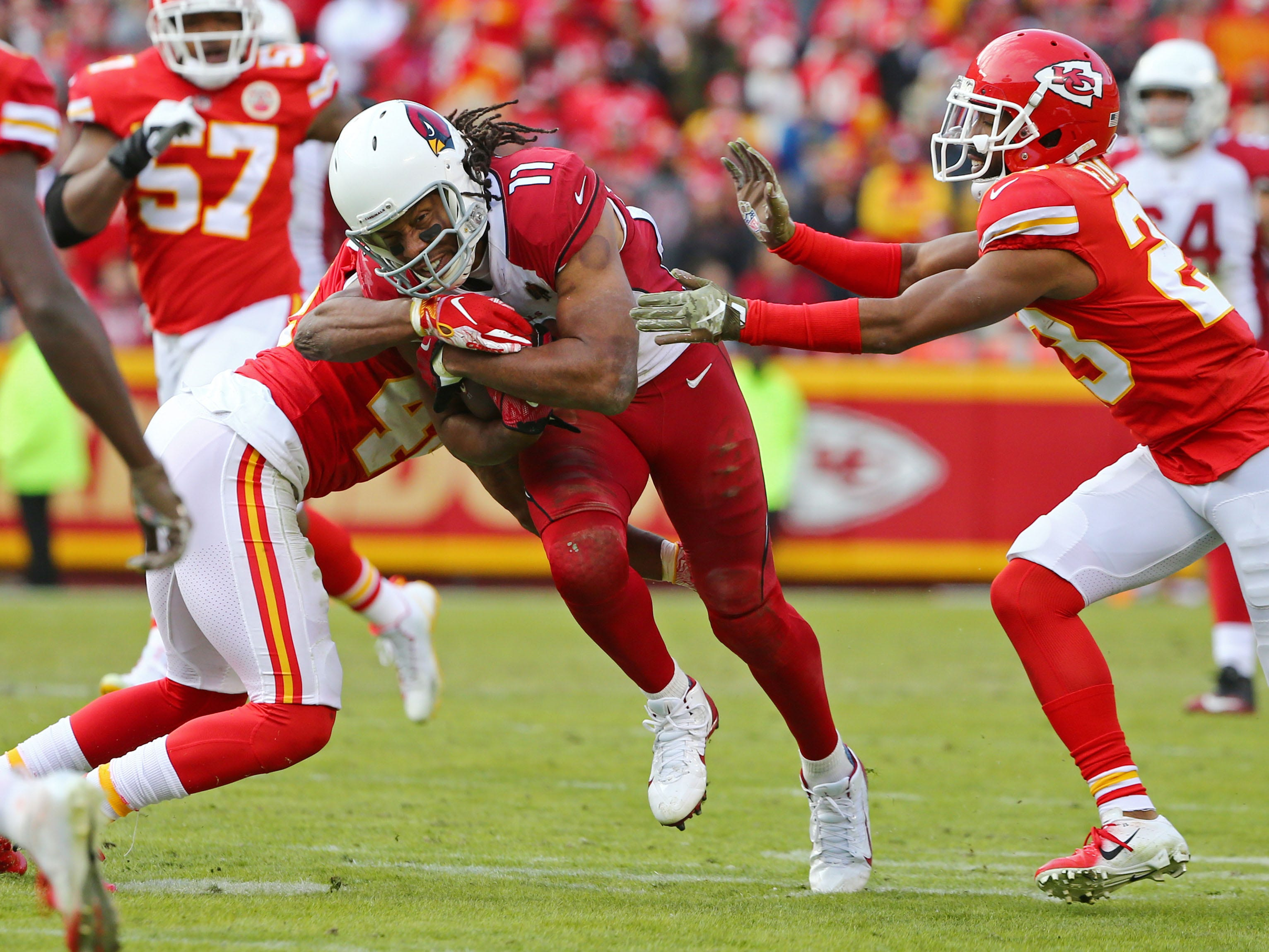 Nov 11, 2018; Kansas City, MO, USA; Arizona Cardinals wide receiver Larry Fitzgerald (11) is tackled by Kansas City Chiefs linebacker Dorian O'Daniel (44) and cornerback Kendall Fuller (23) in the second half at Arrowhead Stadium. Mandatory Credit: Jay Biggerstaff-USA TODAY Sports