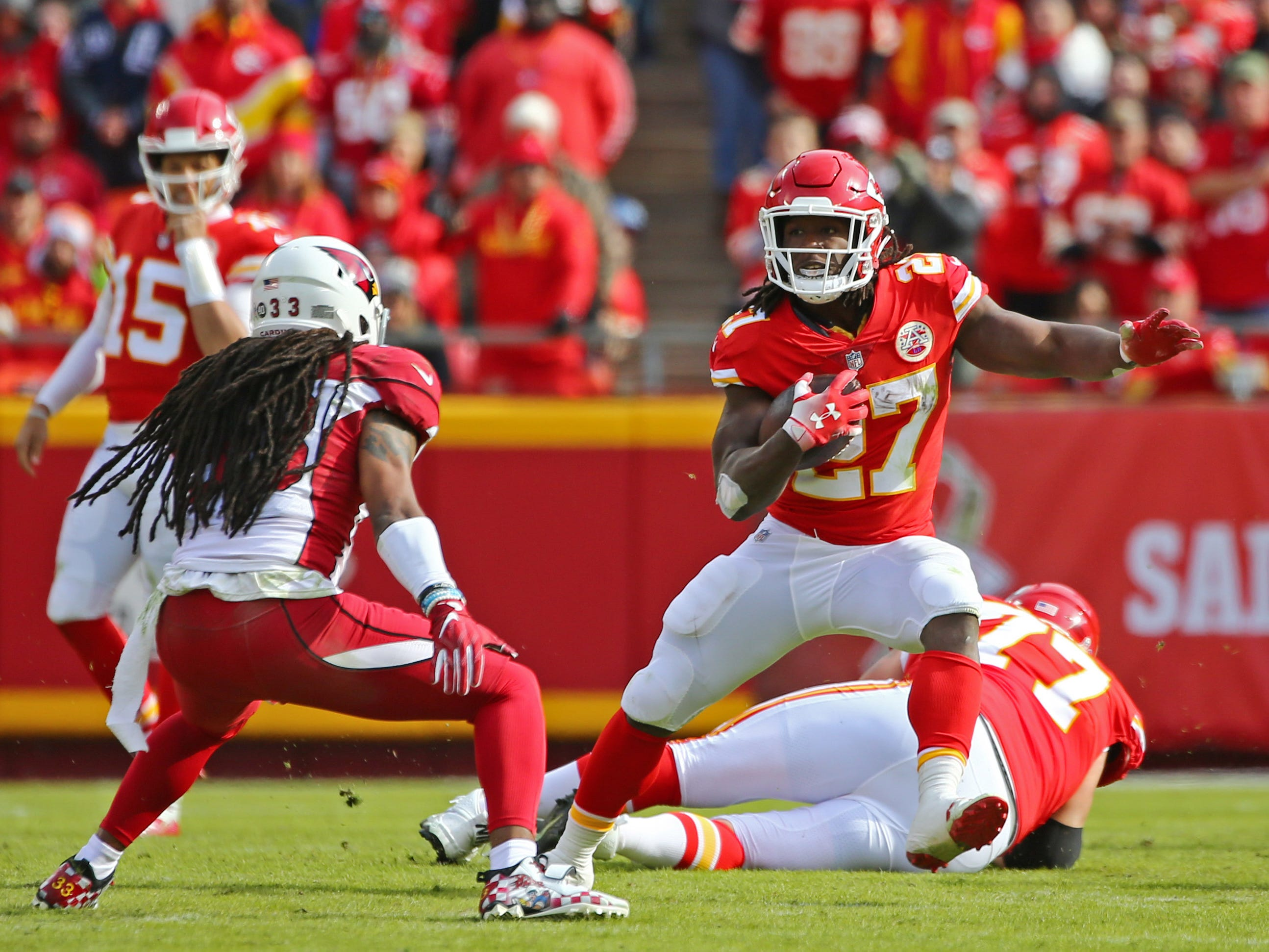 Nov 11, 2018; Kansas City, MO, USA; Kansas City Chiefs running back Kareem Hunt (27) runs against Arizona Cardinals safety Tre Boston (33) in the first half at Arrowhead Stadium. Mandatory Credit: Jay Biggerstaff-USA TODAY Sports