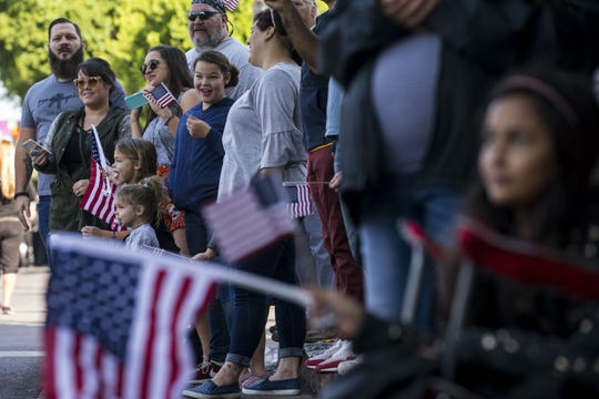 People watch the Veterans Day Parade on Nov. 11, 2018, in Tempe, Ariz.