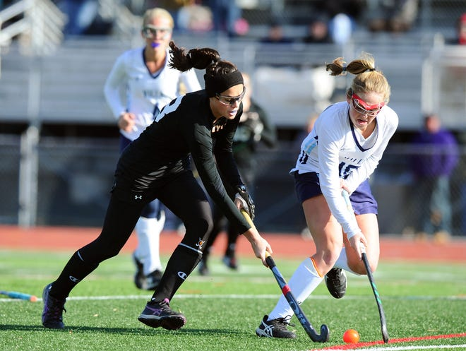 Palmyra's Mia Julian, left, shown here in the state playoffs last year, led the Cougars to Saturday's 2A state title game with a pair of goals in Tuesday's semifinal win over Twin Valley.