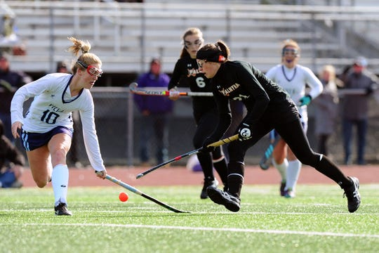 Palmyra's Lauren Wadas, right, helped the Palmyra field hockey team to a state runner-up finish in Class 2A.