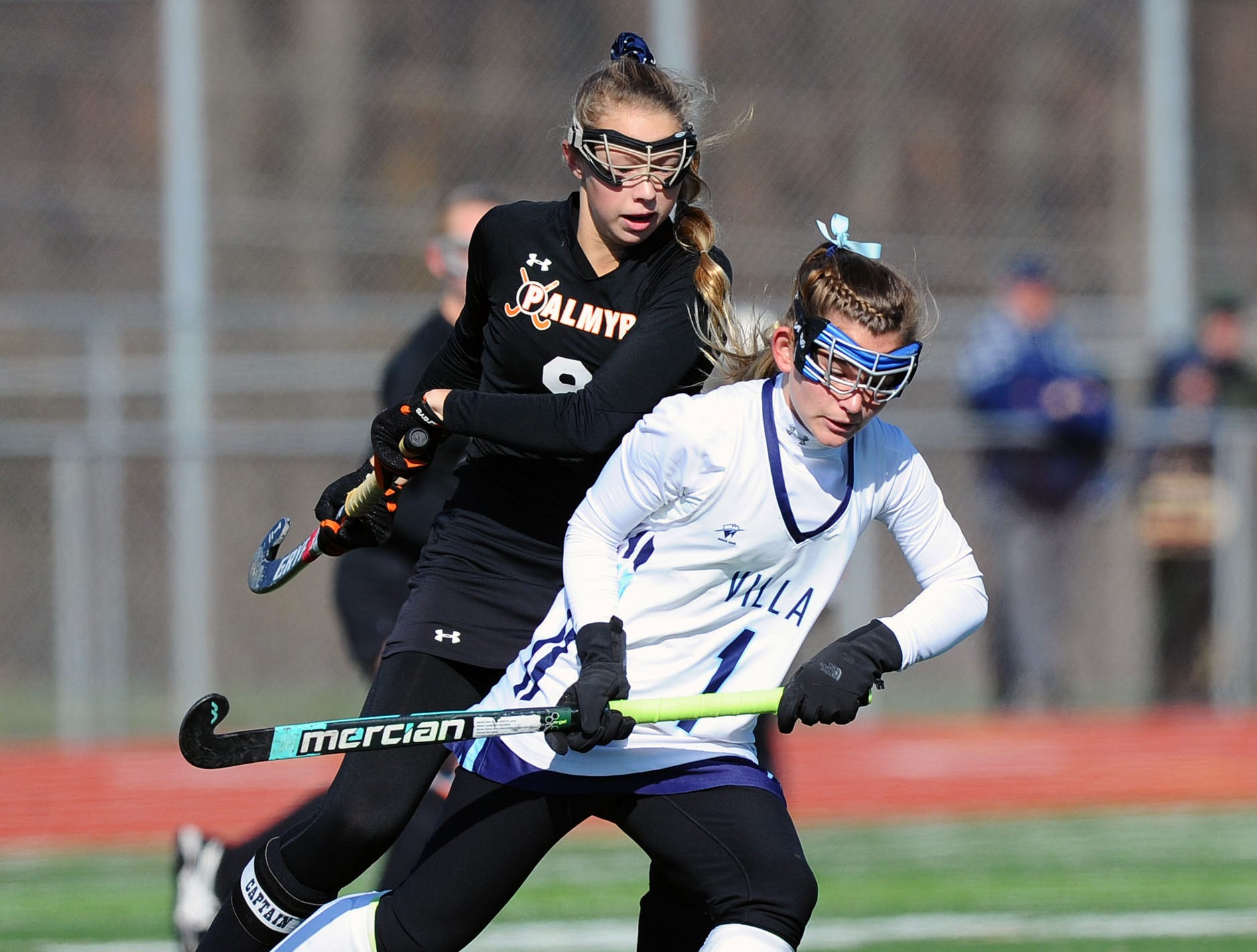 Palmyra's Nicole Shank (9) fights for the ball at mid-field with Villa Maria's Annie Shaw (1) during the first half of play.