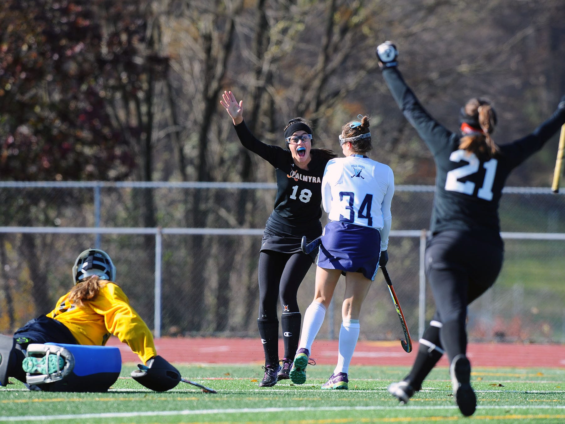 Mia Julian and her teammates celebrate after she ties game 1-1 in the first half.