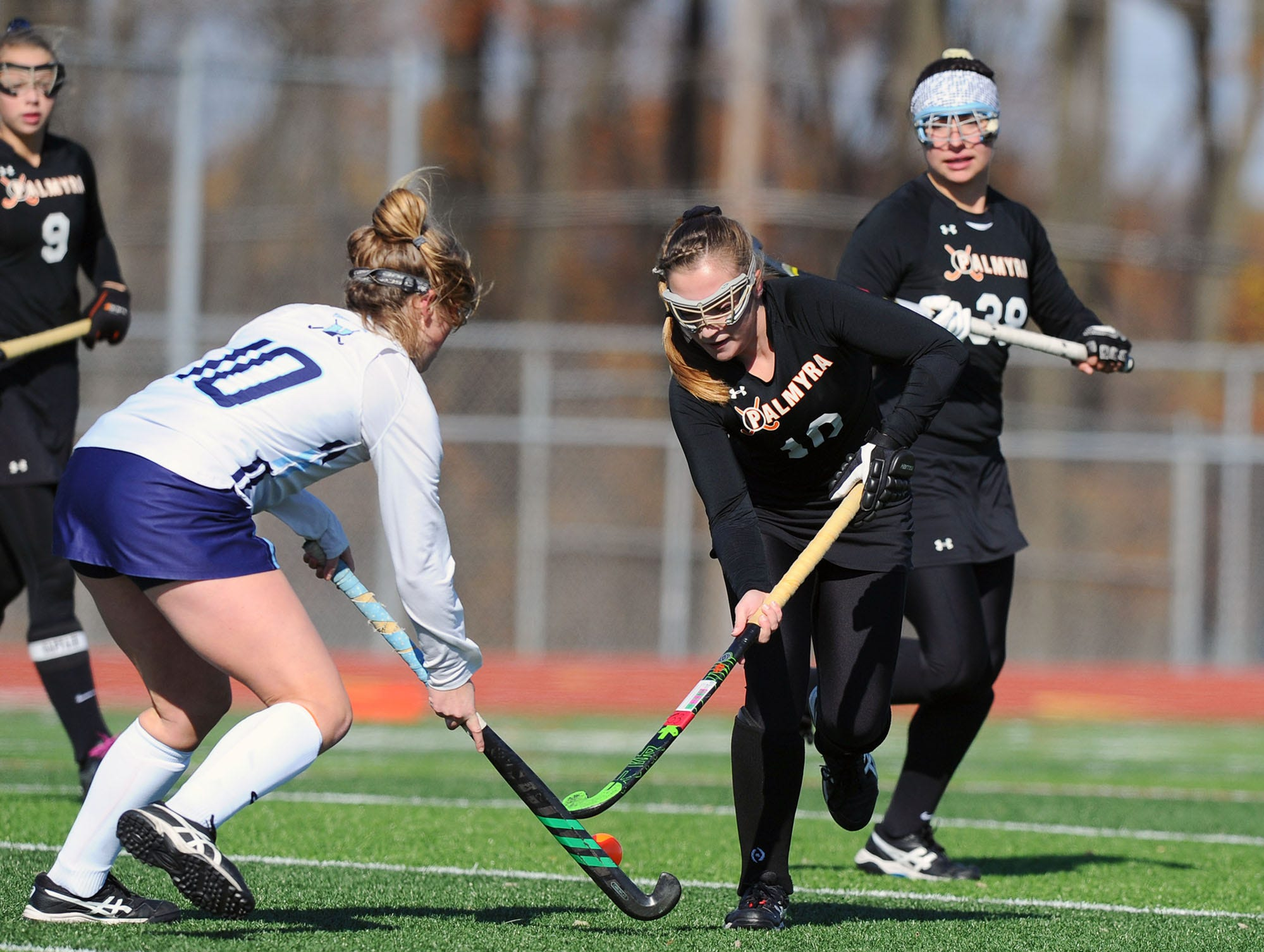 Palmyra's Alexa Derr (10) controls the ball in front of Mary Harkins (10) of Villa Maria during the first half of play.