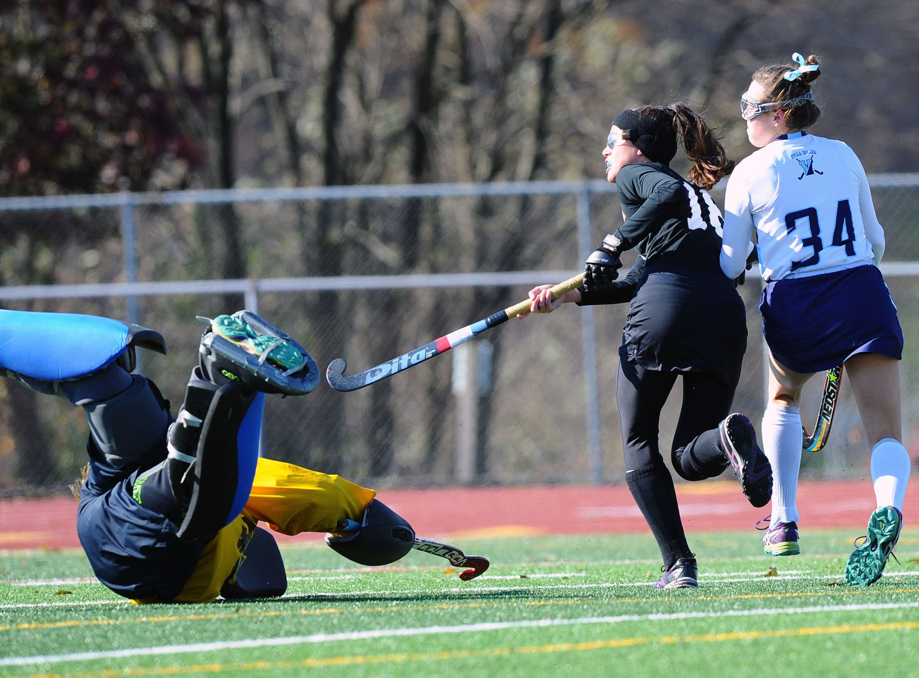 Mia Julian (18) ties the game 1-1 in the first half shooting this shot past the Villa Maria goalie.  Photo Jeff Ruppenthal