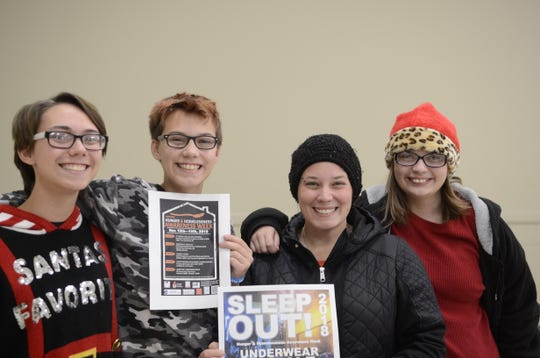 From left, Alex, Chris, Michelle and Taylor Biberston participated in the Road Rally as part of National Hunger and Homelessness Awareness Week on Sunday, Nov. 11, 2018, in Port Huron, Michigan.
