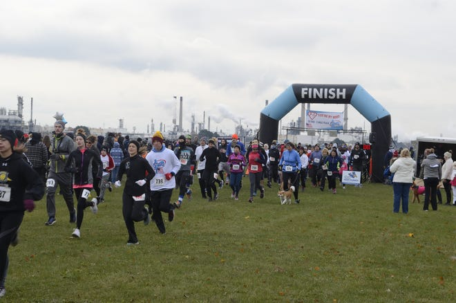 Runners take off during at the start of the 2018 P.S. You're My Hero P.S. You're My Hero 5K Run and 2 Mile Walk on Nov. 11, 2018, in Port Huron, Michigan.