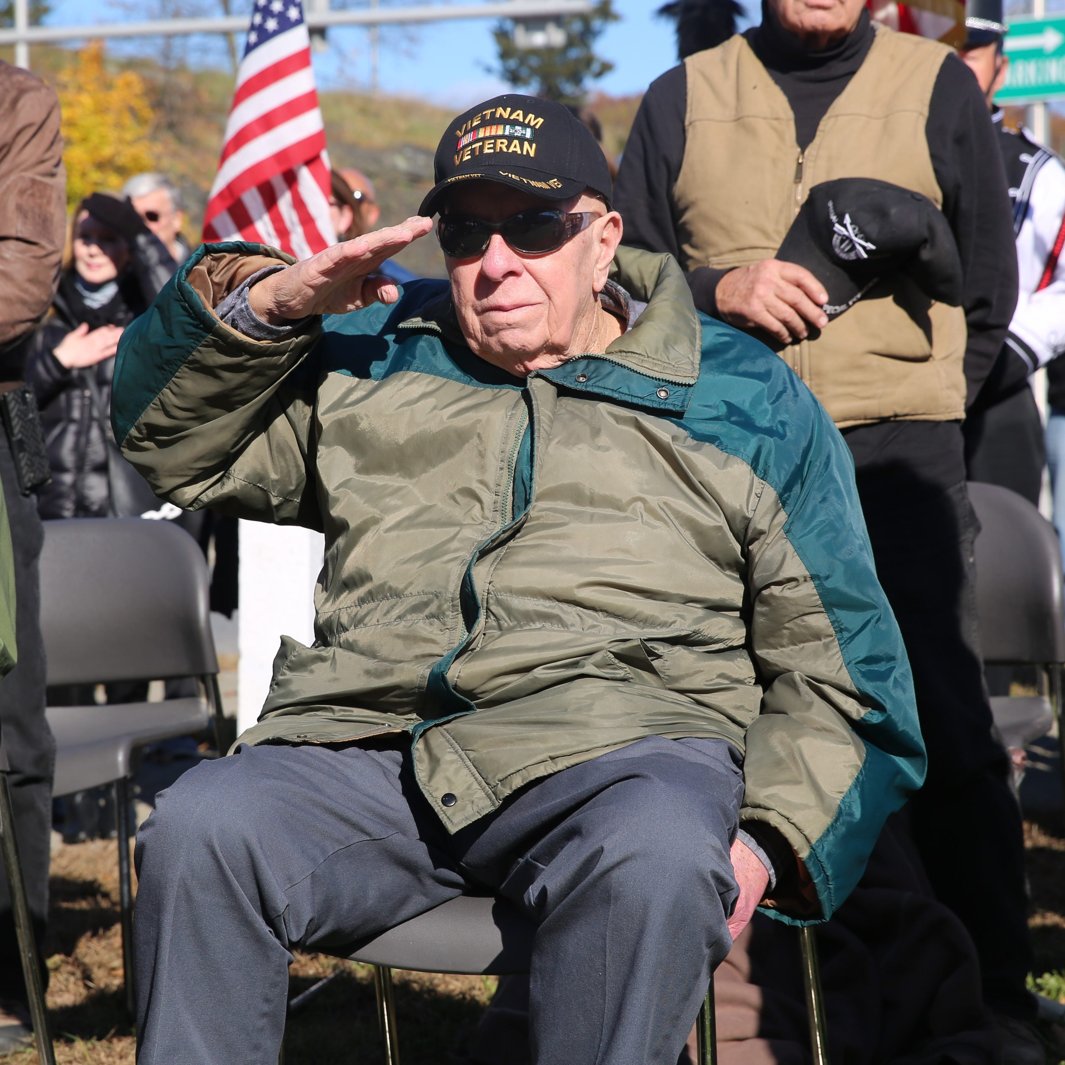 George Kennedy, a 75-year-old Vietnam War veteran from the Town of Beekman, raises a salute during the singing of the national anthem at the annual Dutchess County Veterans Day ceremony on Sunday. For veterans, he said the day is about stopping to think about the people with which they served.