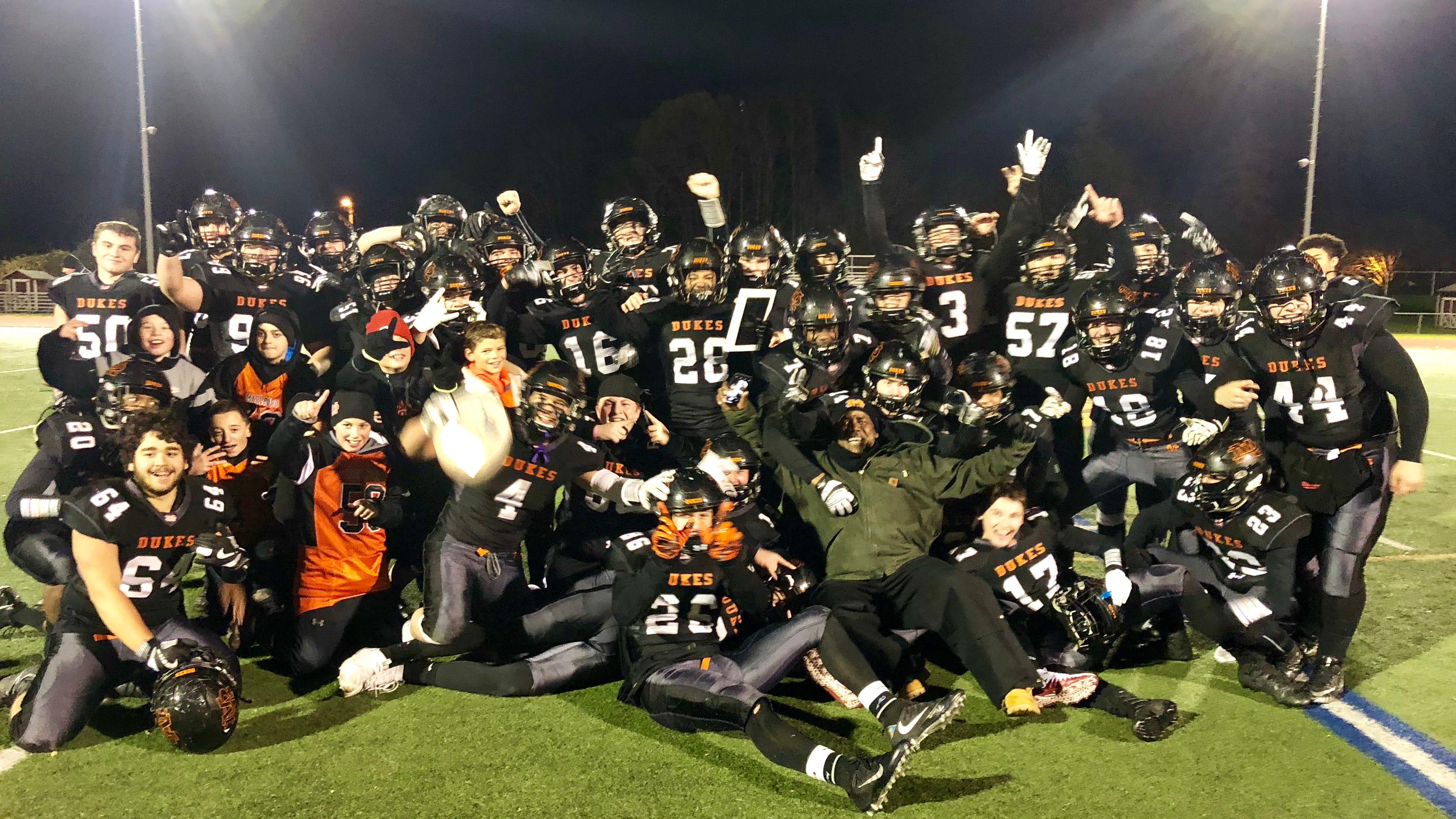 The Marlboro football team poses after winning the Class B regional title at Dietz Stadium.