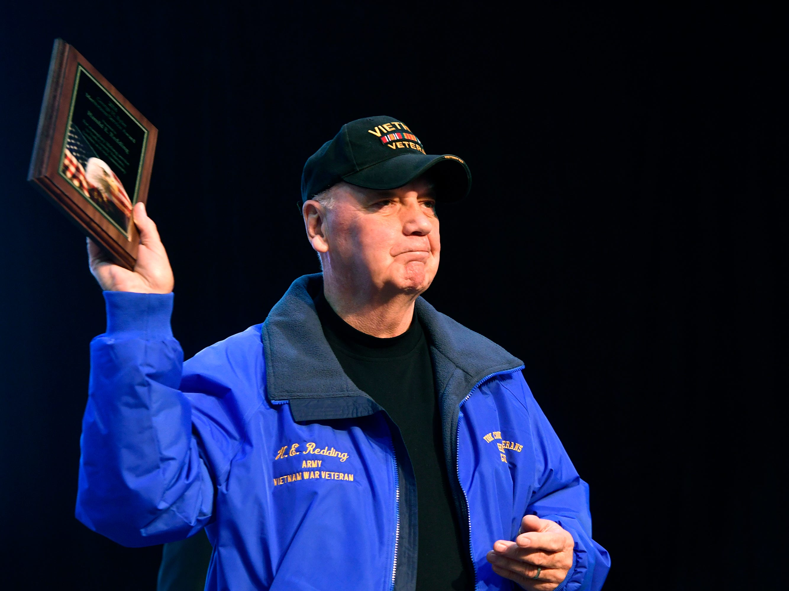Vietnam veteran Harold Redding holds up his George H. Eyler Meritorious Service Award during the 2018 York County Veterans Day Celebration, Sunday, November 11, 2018. Redding was honored for his tireless service to veterans and particularly his efforts for the official recognition of National Vietnam Veterans Day.John A. Pavoncello photo