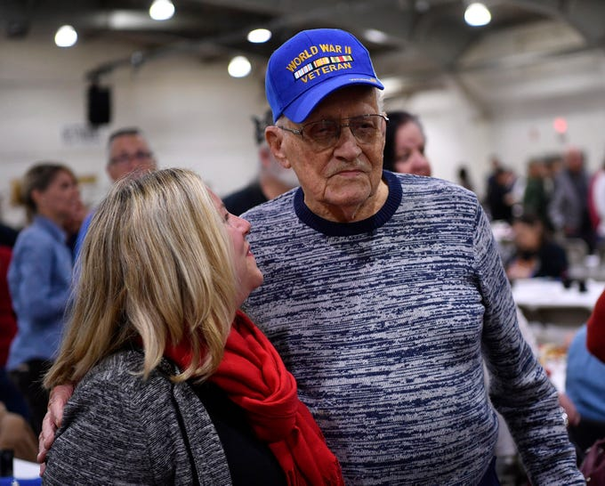 Rep. Kate Klunk, R- Hanover, wishes WWII veteran Carl Alwine a happy 101st birthday during the 2018 York County Veterans Day Celebration, Sunday, November 11, 2018. Alwine, of Spring Grove, served with General Douglas MacArthur. John A. Pavoncello photo