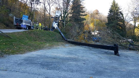 A large, long boom from a tree removal truck lies splayed on Accomac Road in Hellam Township.