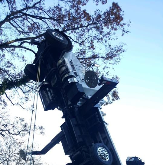 Tree removal truck upended on Accomac Road, police say