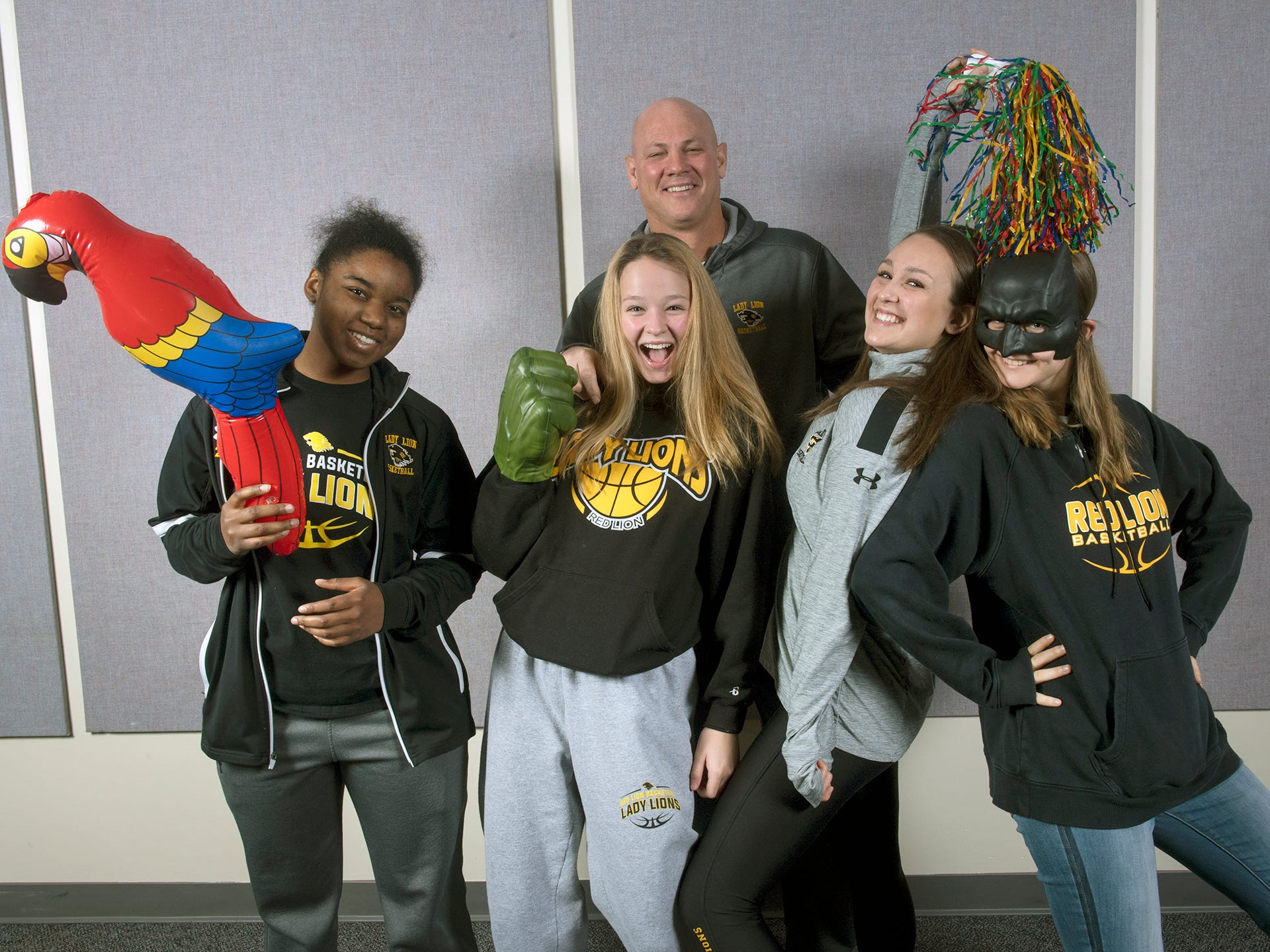 From the left in the front row, Jordyn Foster, Sydney Smith, Riley Miller, Alleney Klunk with Coach Don Dimoff in the back row, of the Red Lion girls basketball team, pose during the 2018-19 GameTimePa YAIAA Winter Media Day Sunday November 11, 2018.