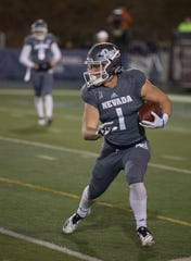 Nevada wide receiver McLane Mannix runs after making a catch Saturday night.