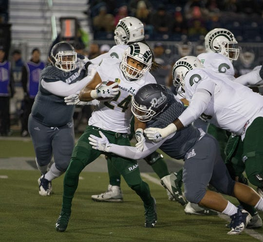 Colorado State running back Izzy Matthews (24) is stopped by the Nevada defense during the Wolf Pack's 49-10 win.