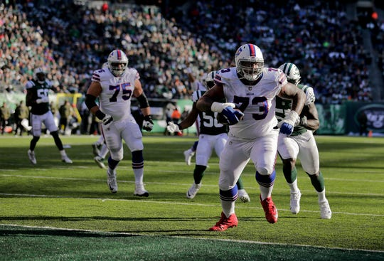 Buffalo Bills offensive tackle Dion Dawkins (73) rumbles into the end zone to score a touchdown against the New York Jets during the second quarter of Sunday's 41-10 in in East Rutherford, N.J.