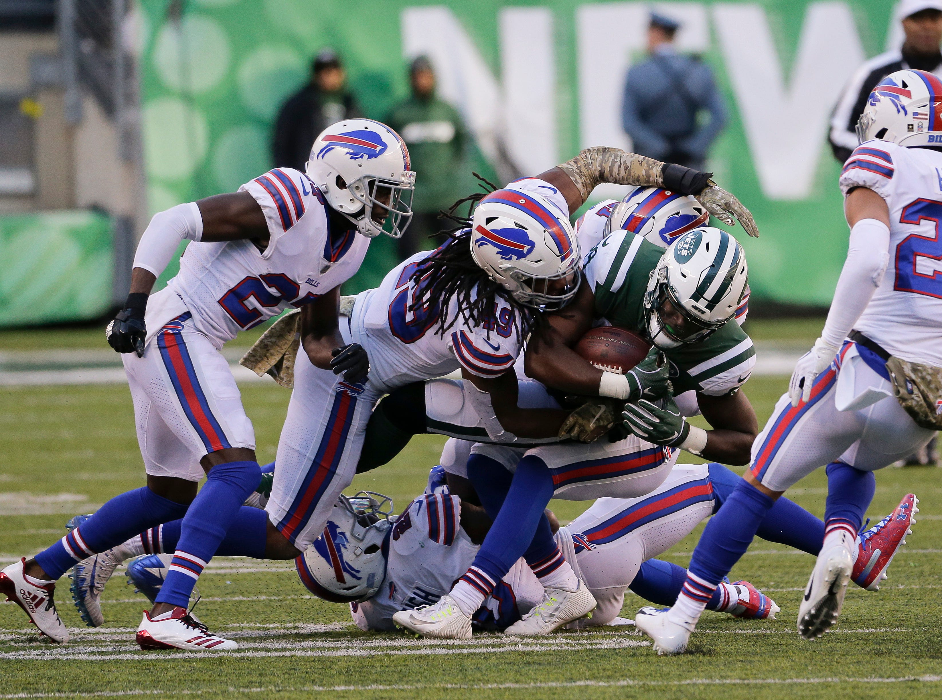 New York Jets tight end Chris Herndon (89) is tackled by the Buffalo Bills during the second quarter of an NFL football game, Sunday, Nov. 11, 2018, in East Rutherford, N.J. (AP Photo/Seth Wenig)