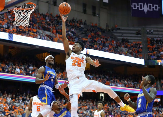 Syracuse guard Tyus Battle (25) shoots the ball over the defense of Morehead State Eagles guard A.J. Hicks (0) during Saturday night's game at the Carrier Dome. Battle led SU with 23 points.