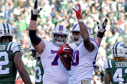 Buffalo Bills tight end Jason Croom, right, celebrates his first quarter touchdown with teammate Wyatt Teller during a 41-10 win over the New York Jets on Nov. 11.