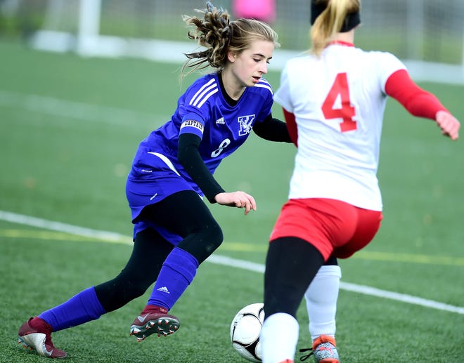 Kendall's Hailee Mitchell makes a move against a Fort Ann defender. Mitchell scored the only goal in the Eagles' 1-0 win in the state Class D title match.