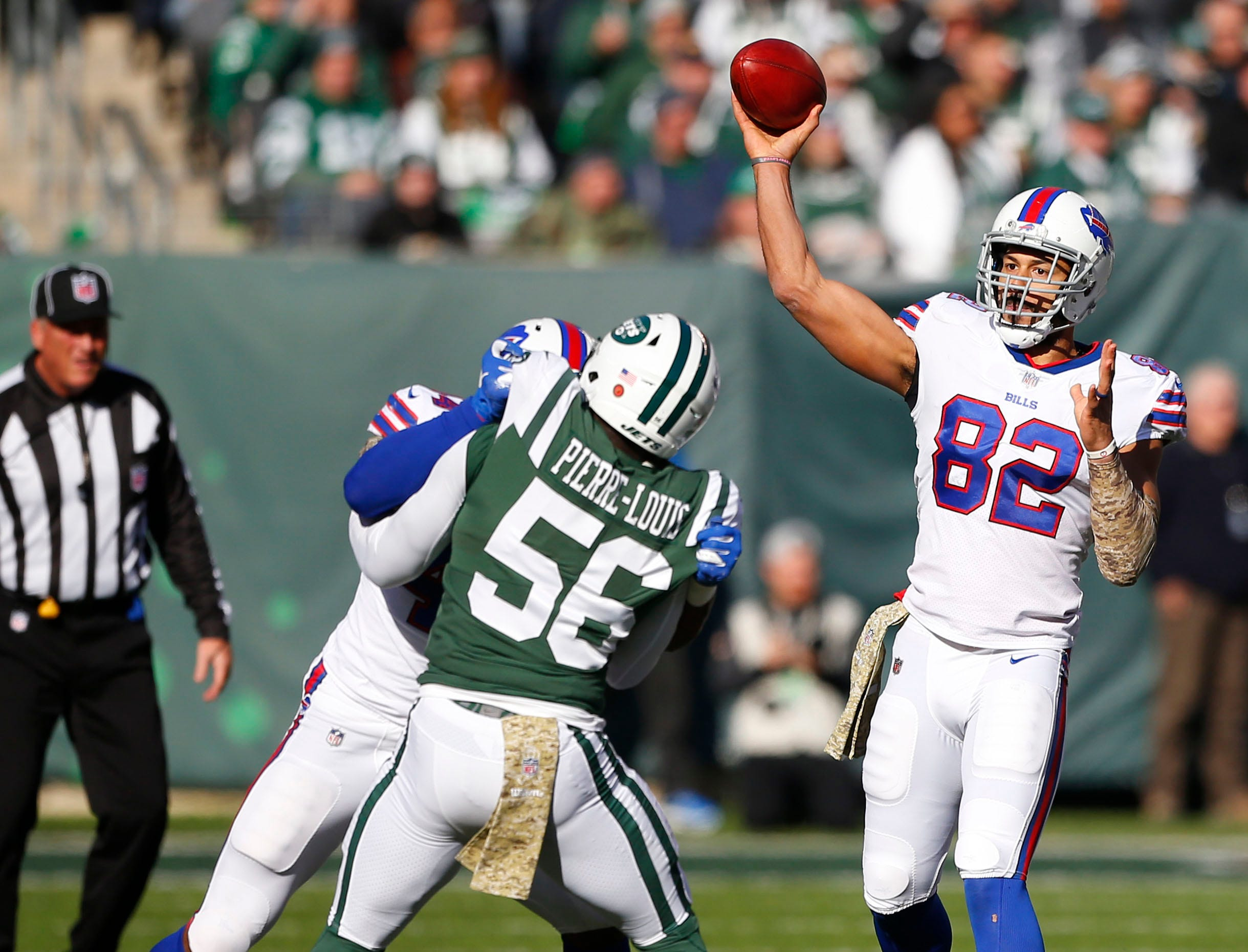 Nov 11, 2018; East Rutherford, NJ, USA;Buffalo Bills tight end Logan Thomas (82) throws a pass against the New York Jets during the first quarter at MetLife Stadium. Mandatory Credit: Noah K. Murray-USA TODAY Sports