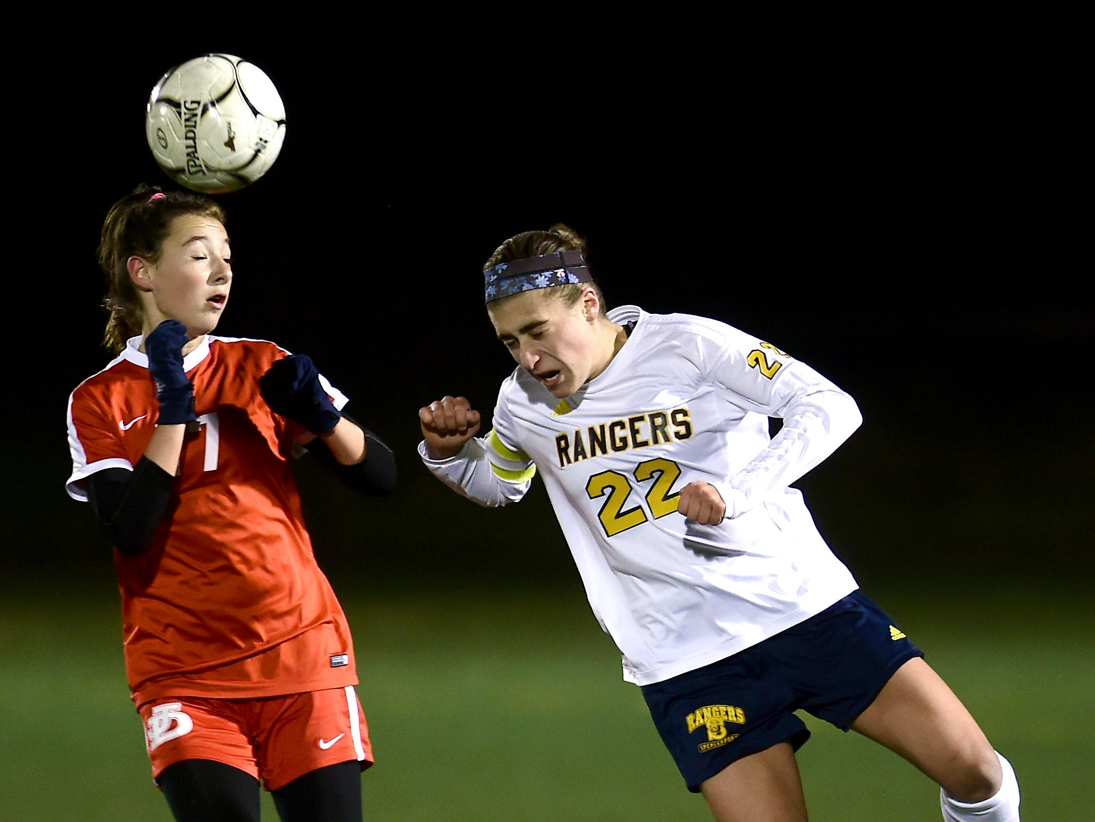 Spencerport's Olivia Wall (22) heads the ball past Jamesville-DeWitt's Sydney Balotin (7) during the Class A NYSPHSAA Girls Soccer Championship semifinal at Tompkins Cortland Community College on Nov. 10, 2018.