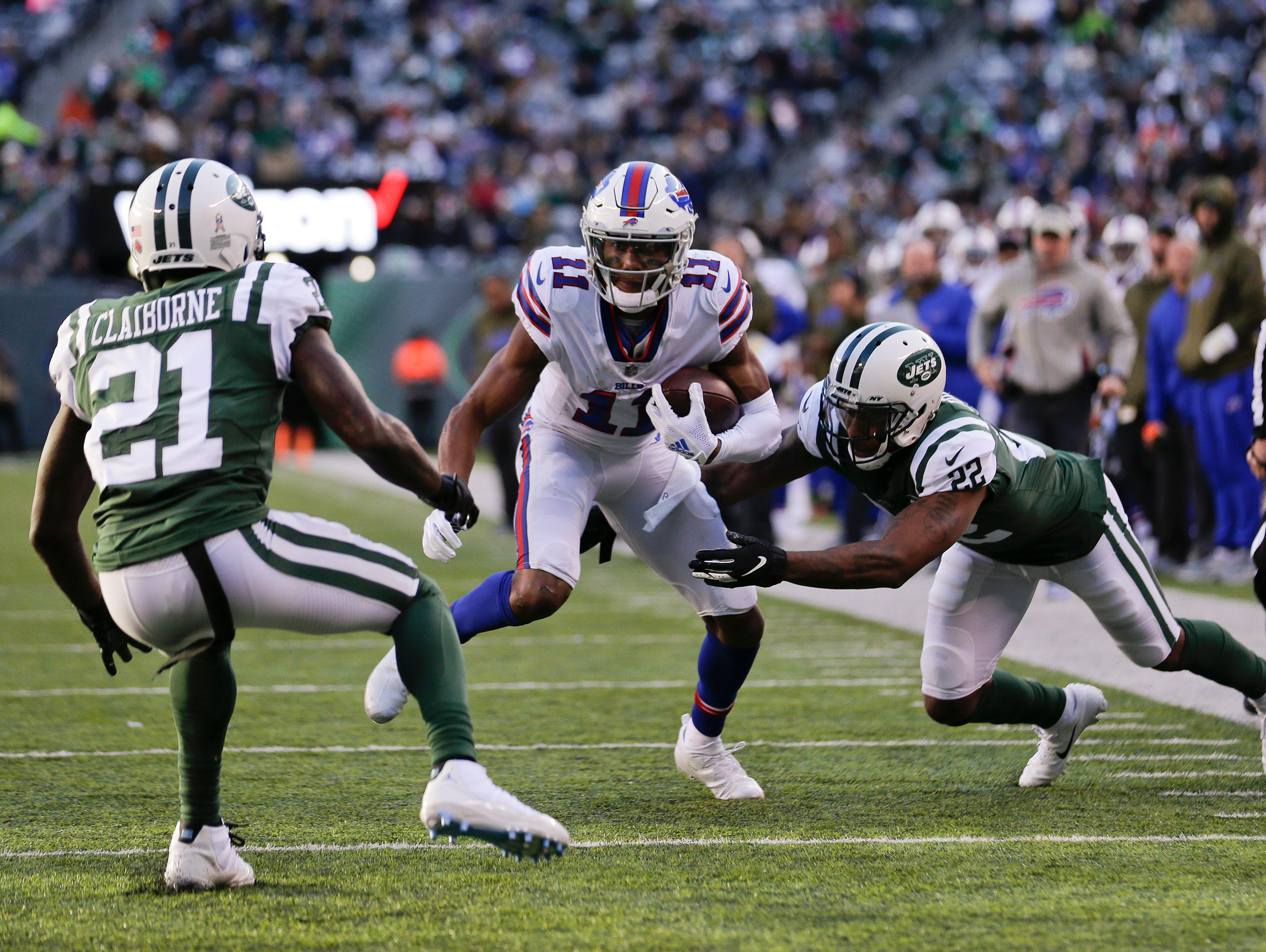 Buffalo Bills wide receiver Zay Jones (11) tries to evade New York Jets cornerback Trumaine Johnson (22) and cornerback Morris Claiborne (21) during the third quarter of an NFL football game, Sunday, Nov. 11, 2018, in East Rutherford, N.J. (AP Photo/Seth Wenig)