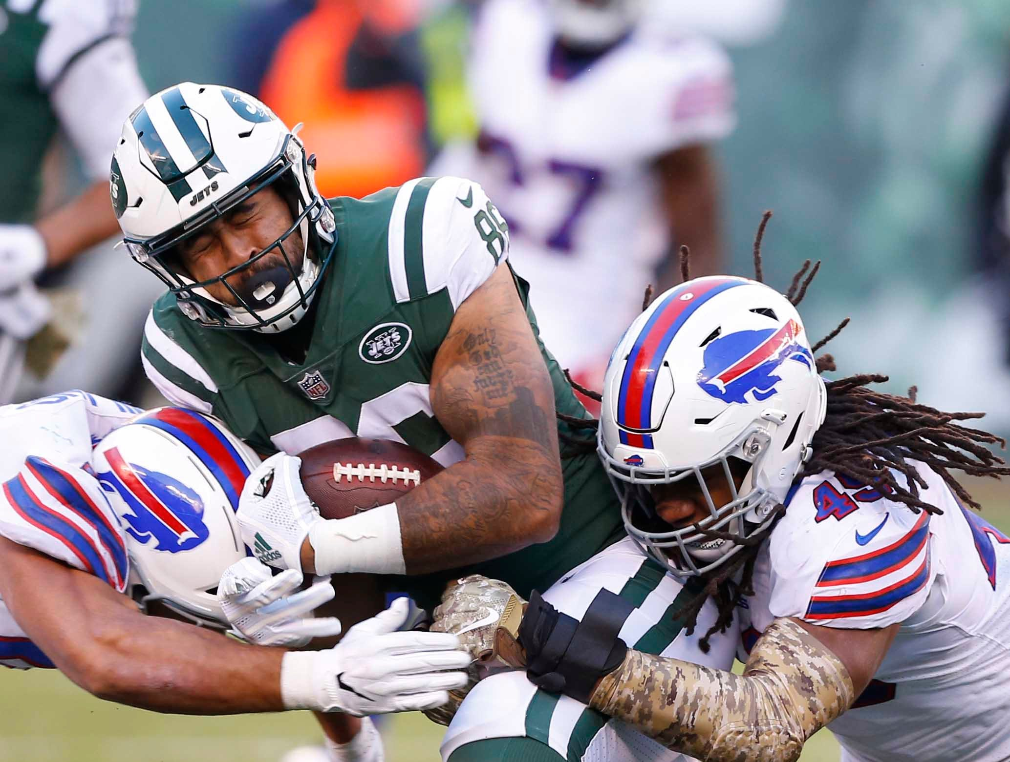 Nov 11, 2018; East Rutherford, NJ, USA; New York Jets tight end Jordan Leggett (86) is tackled by Buffalo Bills outside linebacker Matt Milano (58) and middle linebacker Tremaine Edmunds (49) during the second half at MetLife Stadium. Mandatory Credit: Noah K. Murray-USA TODAY Sports
