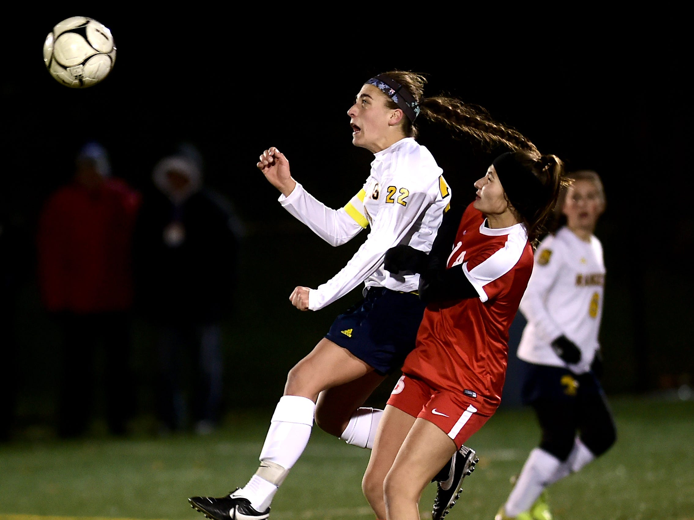Olivia Wall (22) of Spencerport controls the ball past Tonia Kousmanidis (14) of Jamesville-DeWitt during the Class A NYSPHSAA Girls Soccer Championship semifinal at Tompkins Cortland Community College on Nov. 10, 2018.