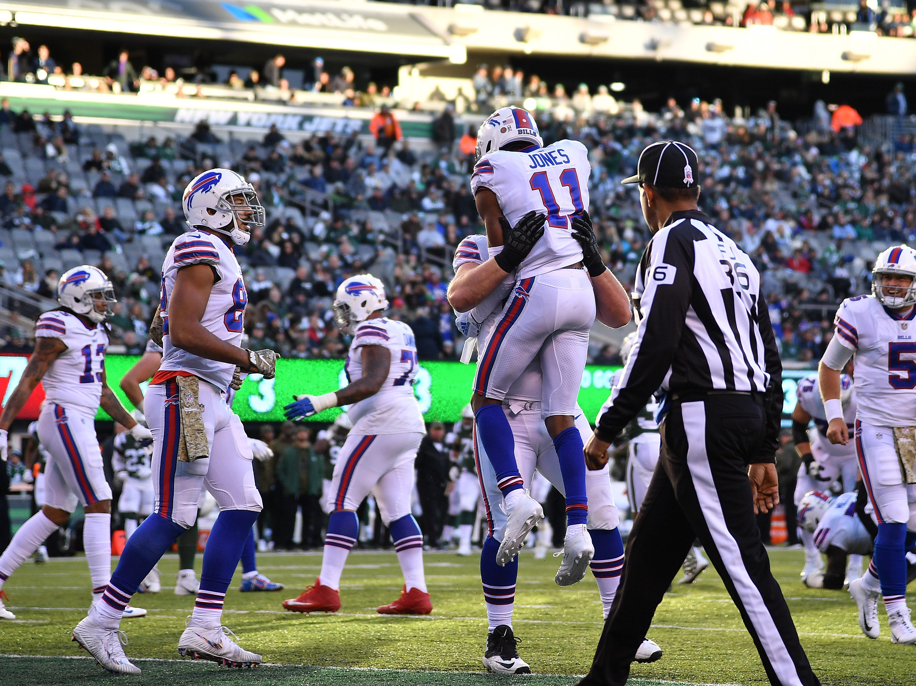 EAST RUTHERFORD, NEW JERSEY - NOVEMBER 11: Zay Jones #11 of the Buffalo Bills is congratulated by his teammates after his third quarter touchdown against the New York Jets at MetLife Stadium on November 11, 2018 in East Rutherford, New Jersey. (Photo by Mark Brown/Getty Images)