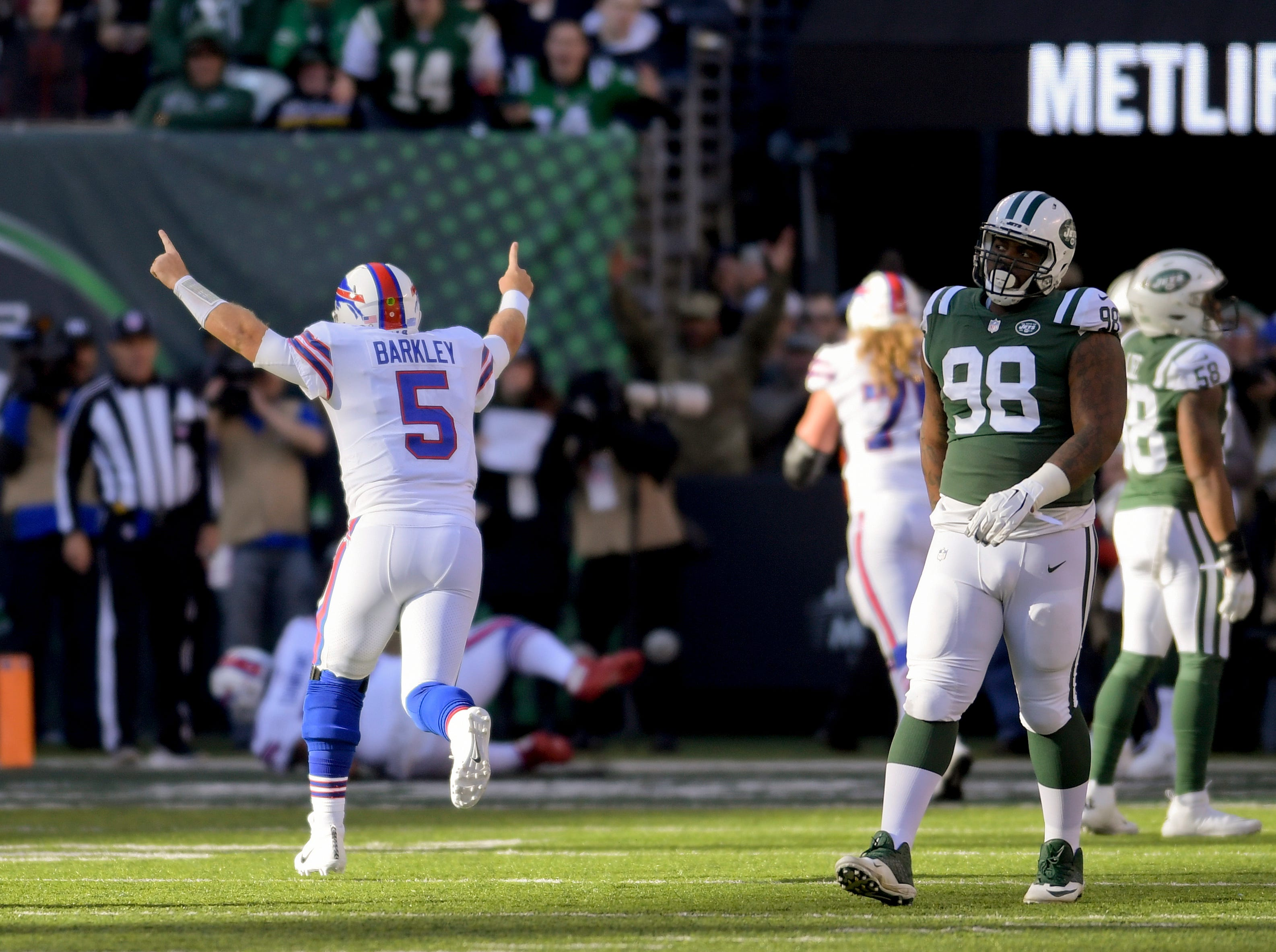 Buffalo Bills quarterback Matt Barkley (5) celebrates after a touchdown against the New York Jets during the second quarter of an NFL football game, Sunday, Nov. 11, 2018, in East Rutherford, N.J. (AP Photo/Bill Kostroun)
