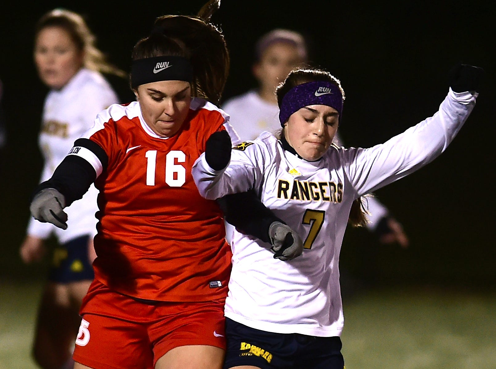 Hayley Quackenbush (16) of Jamesville-DeWitt and Sabrina Trapani (7) of Spencerport battle for control in the first half during the Class A NYSPHSAA Girls Soccer Championship semifinal at Tompkins Cortland Community College on Nov. 10, 2018.