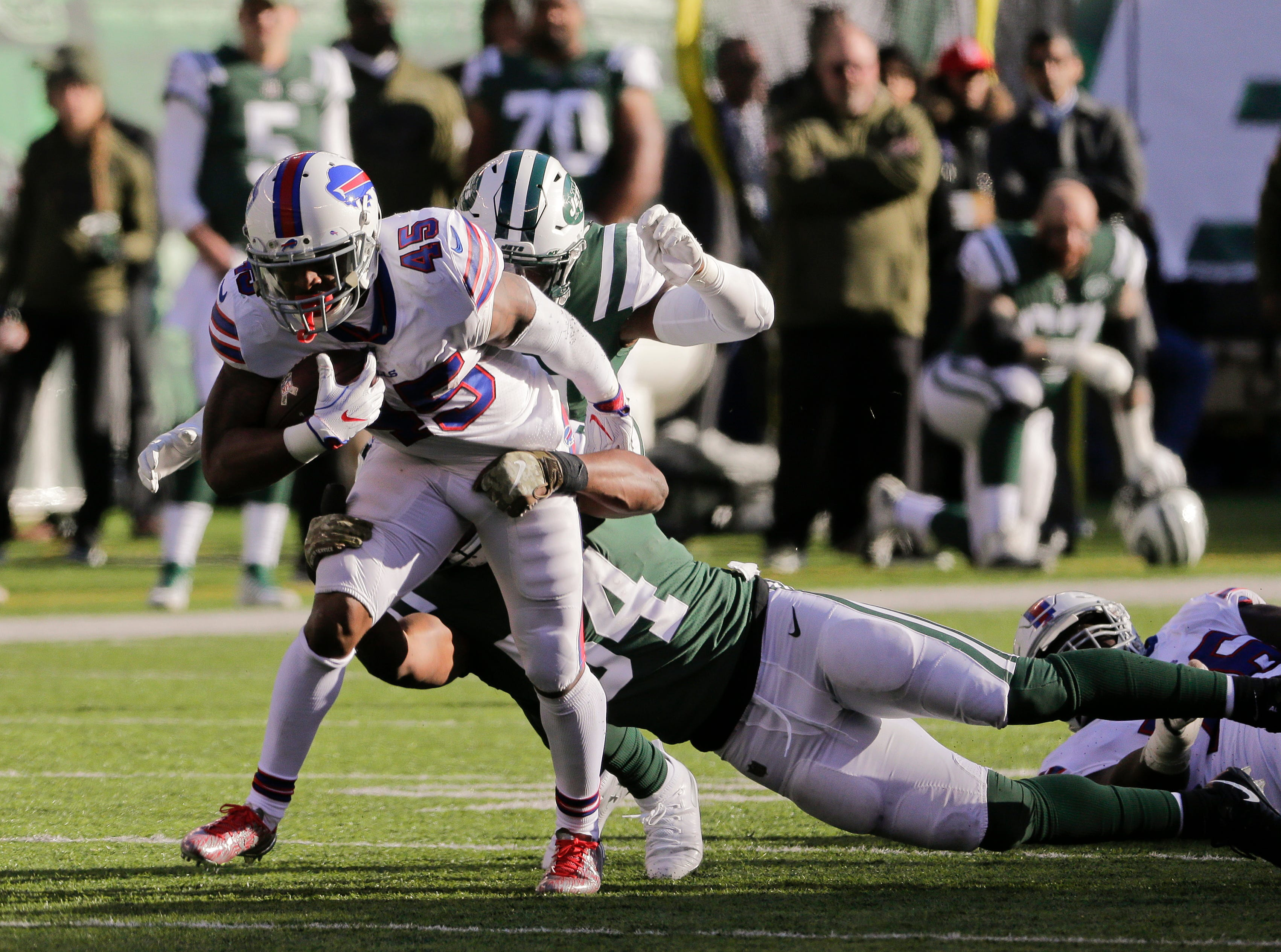 Buffalo Bills running back Marcus Murphy (45) is tackled by New York Jets inside linebacker Avery Williamson (54) during the second quarter of an NFL football game, Sunday, Nov. 11, 2018, in East Rutherford, N.J. (AP Photo/Seth Wenig)
