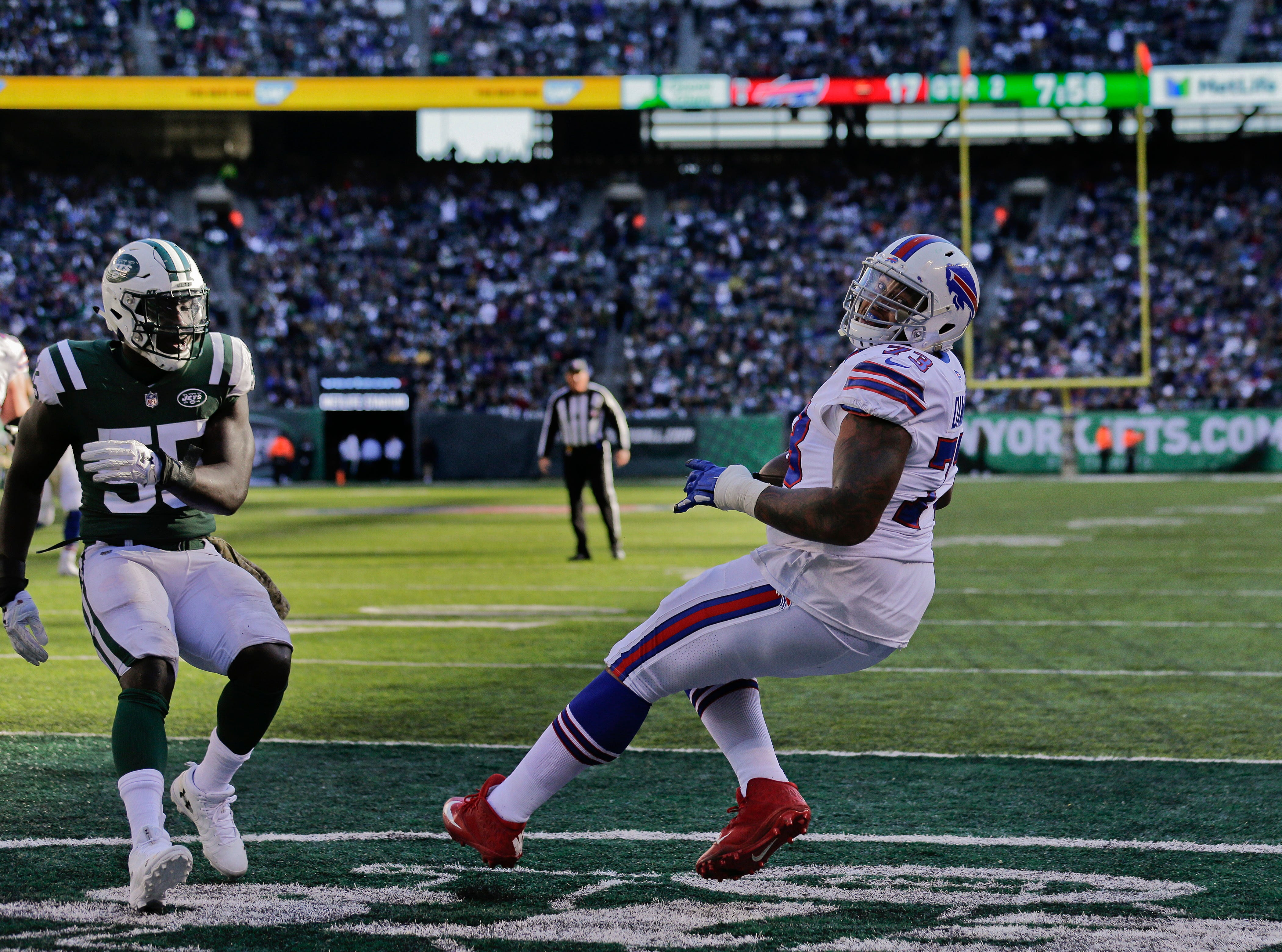 Buffalo Bills offensive tackle Dion Dawkins (73) reacts after scoring a touchdown against the New York Jets during the second quarter of an NFL football game, Sunday, Nov. 11, 2018, in East Rutherford, N.J. (AP Photo/Seth Wenig)