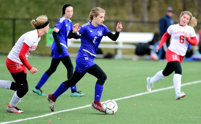 Kendall's Hailee Mitchell attempts to elude the Fort Ann defense in the state Class D championship game.