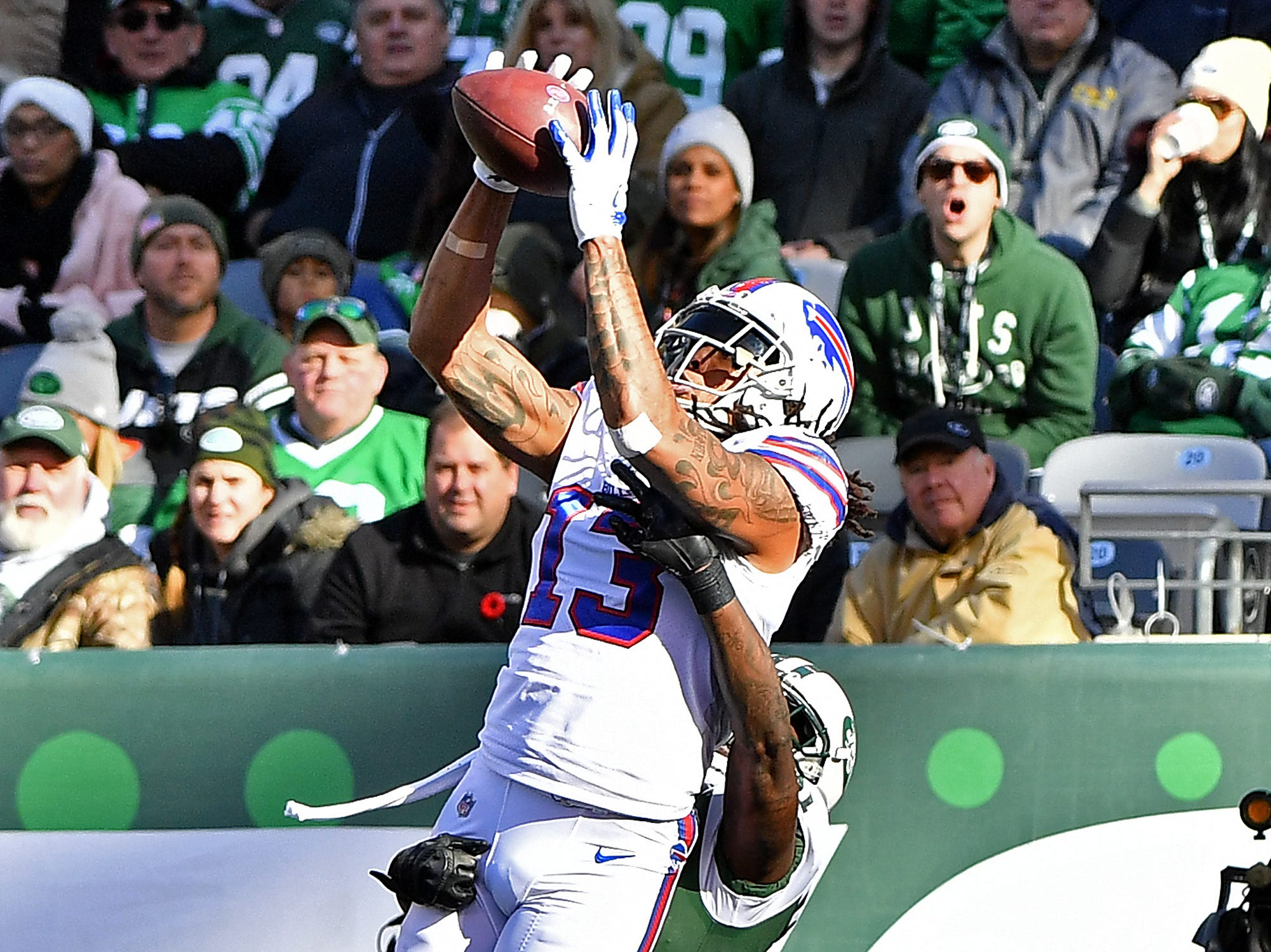 EAST RUTHERFORD, NEW JERSEY - NOVEMBER 11: Kelvin Benjamin #13 of the Buffalo Bills attempts to catch a pass under pressure from Morris Claiborne #21 of the New York Jets during the first quarter at MetLife Stadium on November 11, 2018 in East Rutherford, New Jersey. (Photo by Mark Brown/Getty Images)