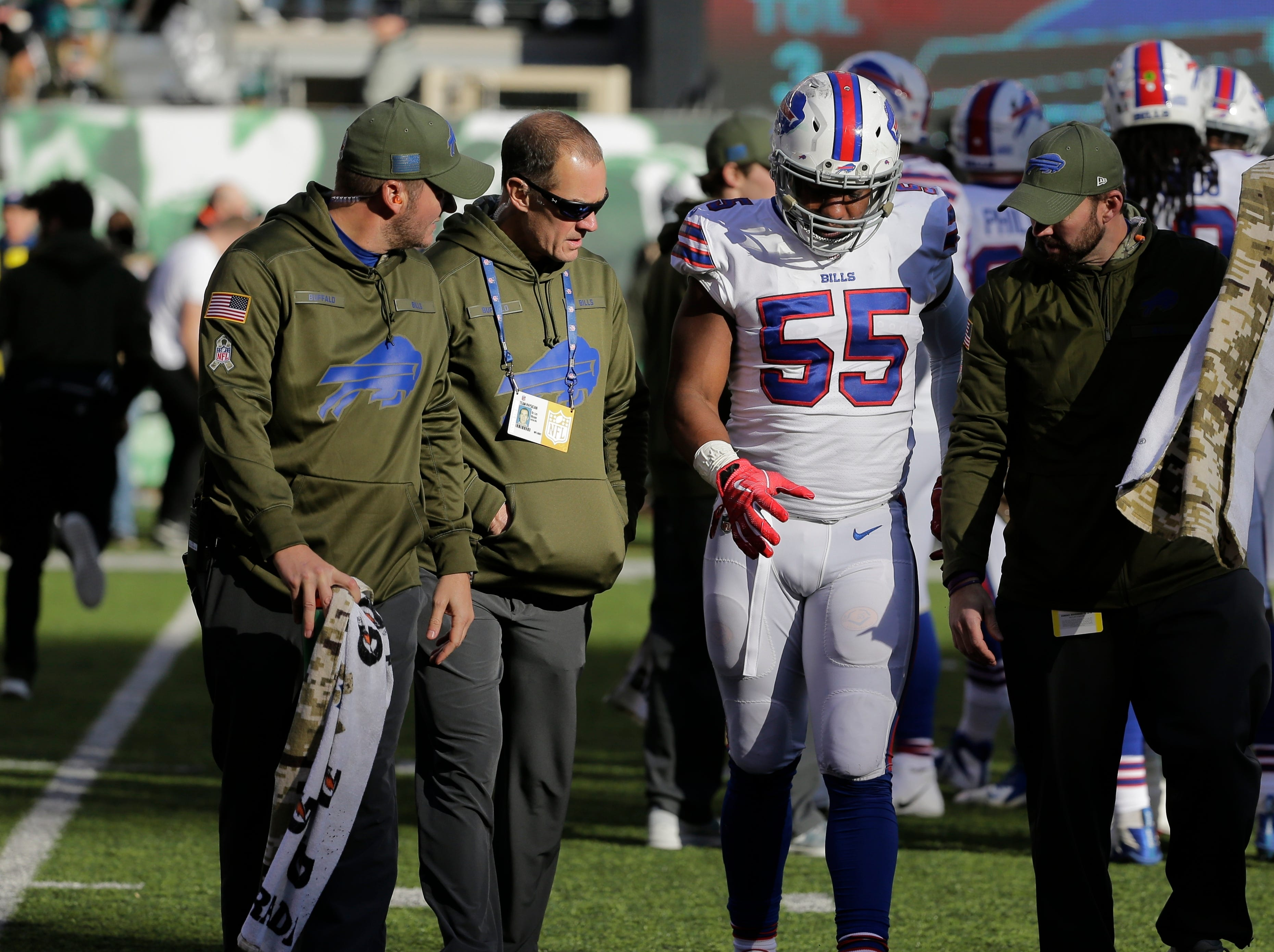 Buffalo Bills defensive end Jerry Hughes (55) is helped off the field after an injury against the New York Jets during the second quarter of an NFL football game, Sunday, Nov. 11, 2018, in East Rutherford, N.J. (AP Photo/Seth Wenig)