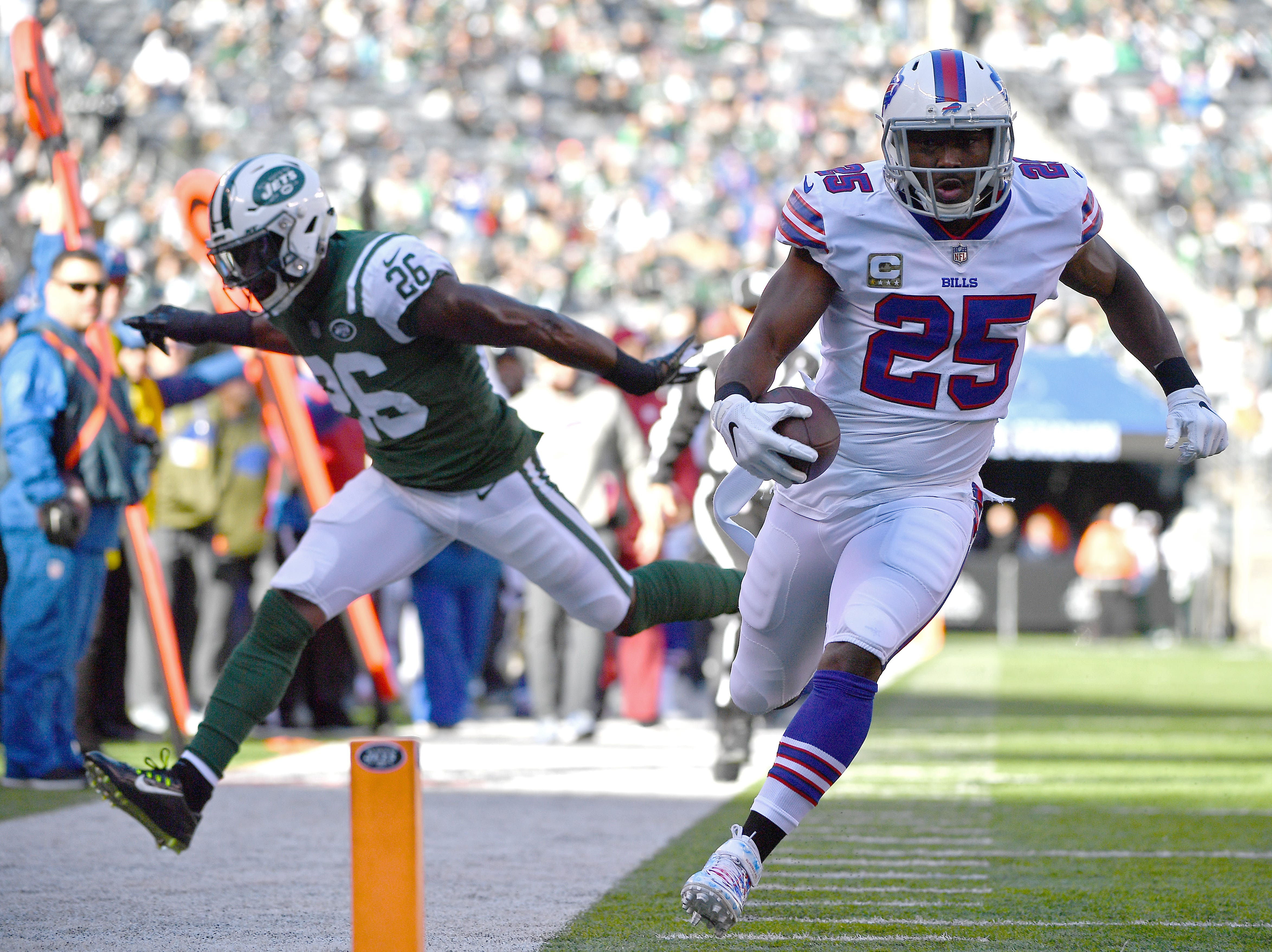 EAST RUTHERFORD, NEW JERSEY - NOVEMBER 11: LeSean McCoy #25 of the Buffalo Bills scores a first quarter rushing touchdown past Marcus Maye #26 of the New York Jets at MetLife Stadium on November 11, 2018 in East Rutherford, New Jersey. (Photo by Mark Brown/Getty Images)