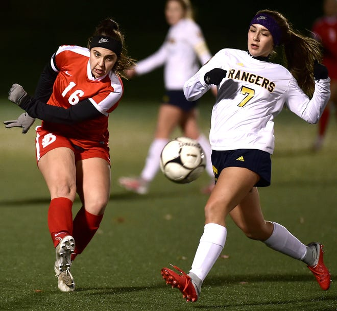 Hayley Quackenbush (16) of Jamesville-DeWitt and Sabrina Trapani (7) of Spencerport battle for control during first half during the Class A NYSPHSAA Girls Soccer Championship semifinal at Tompkins Cortland Community College on Nov. 10, 2018.