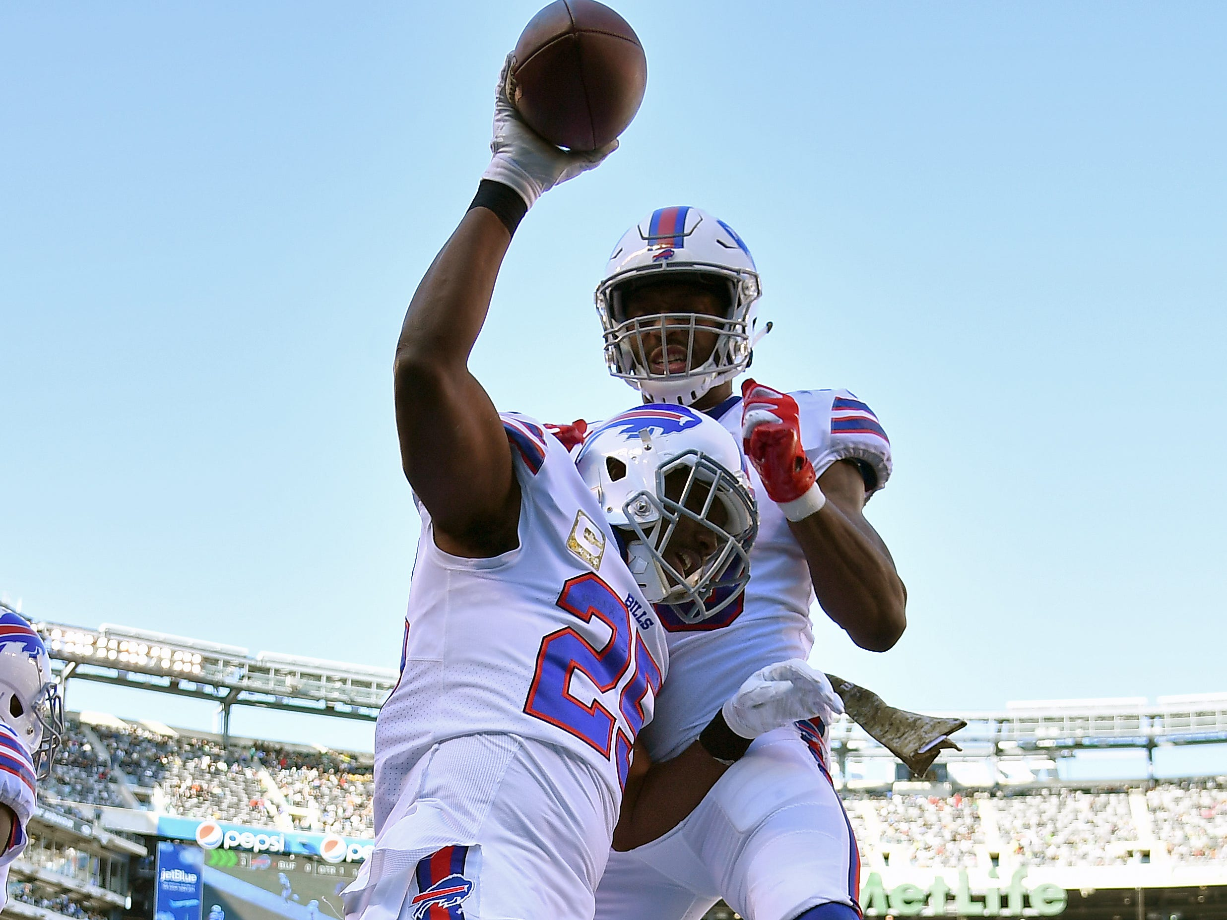 EAST RUTHERFORD, NEW JERSEY - NOVEMBER 11: LeSean McCoy #25 is congratulated by his teammate Jason Croom #80 of the Buffalo Bills after his first quarter rushing touchdown  against the New York Jets at MetLife Stadium on November 11, 2018 in East Rutherford, New Jersey. (Photo by Mark Brown/Getty Images)