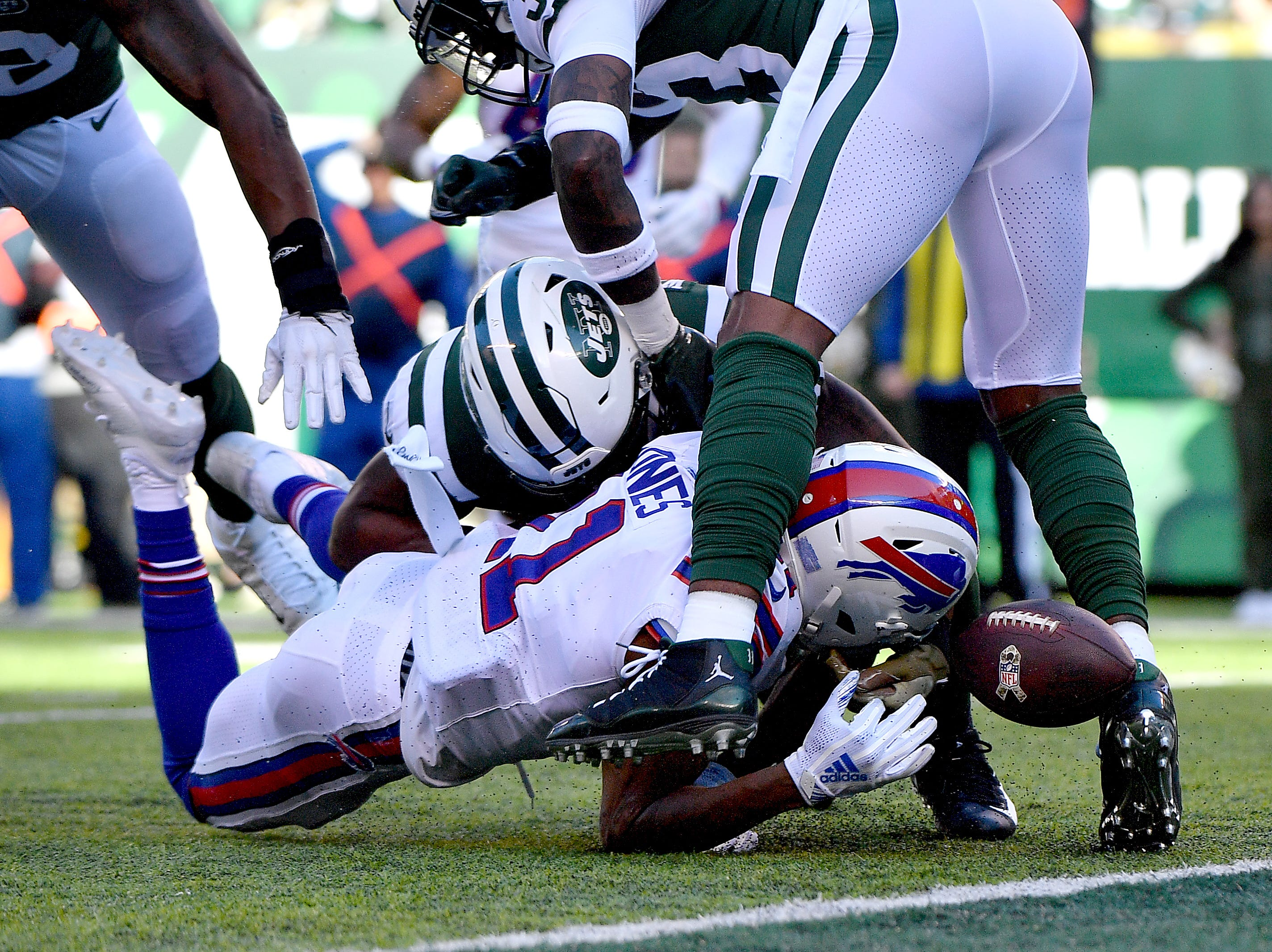 EAST RUTHERFORD, NEW JERSEY - NOVEMBER 11: Zay Jones #11 of the Buffalo Bills fumbles the ball into the end zone that leads to a touchdown by teammate Jason Croom (not pictured) as he is hit by Avery Williamson #54 of the New York Jets during the first quarter at MetLife Stadium on November 11, 2018 in East Rutherford, New Jersey. (Photo by Mark Brown/Getty Images)