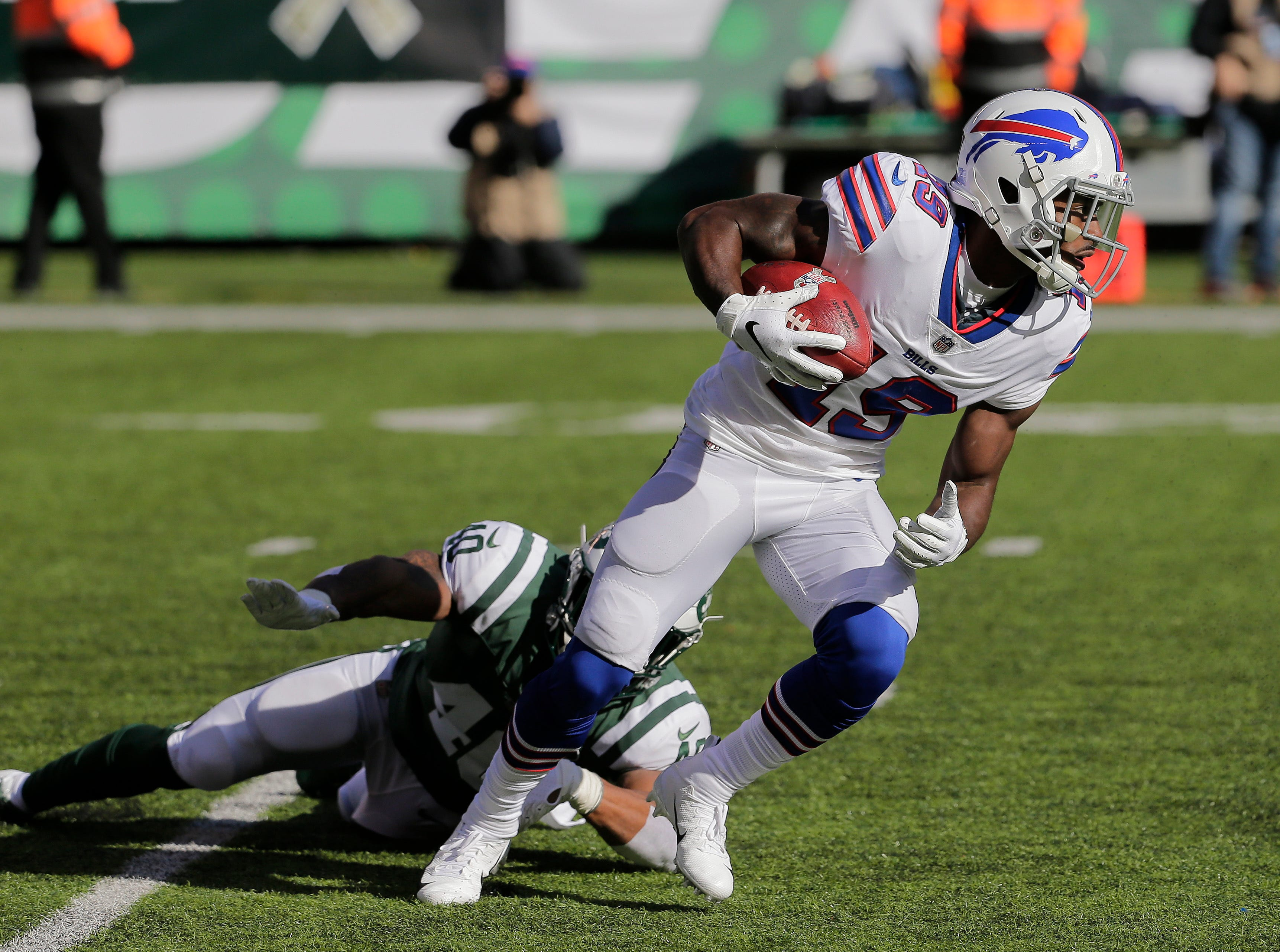 Buffalo Bills wide receiver Isaiah McKenzie (19) runs the ball against the New York Jets during the first quarter of an NFL football game, Sunday, Nov. 11, 2018, in East Rutherford, N.J. (AP Photo/Seth Wenig)
