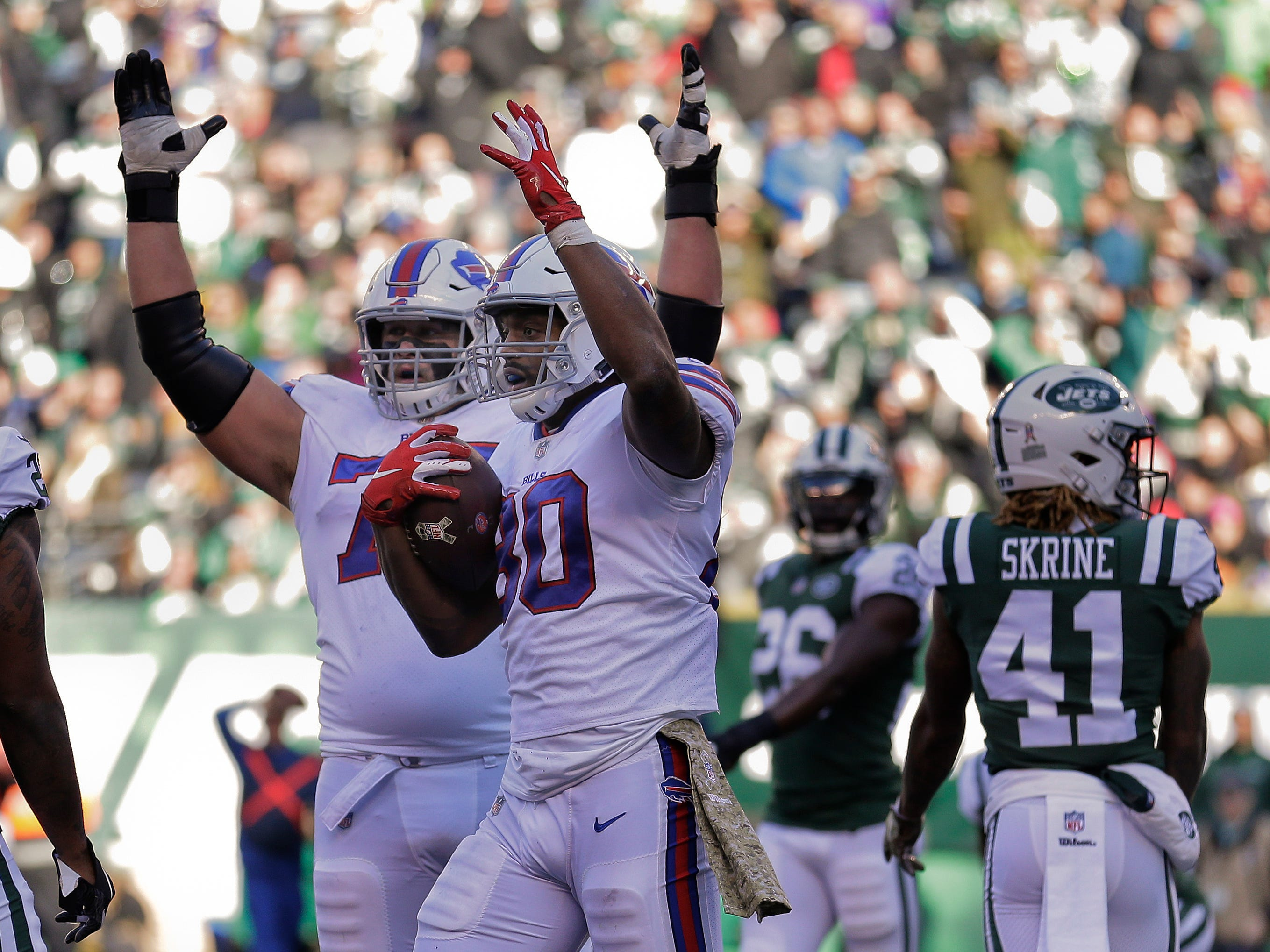 Buffalo Bills tight end Jason Croom (80) and offensive guard Wyatt Teller (75) motion for a touchdown after Croom recovered a fumble in the end zone against the New York Jets during the first quarter of an NFL football game, Sunday, Nov. 11, 2018, in East Rutherford, N.J. (AP Photo/Seth Wenig)