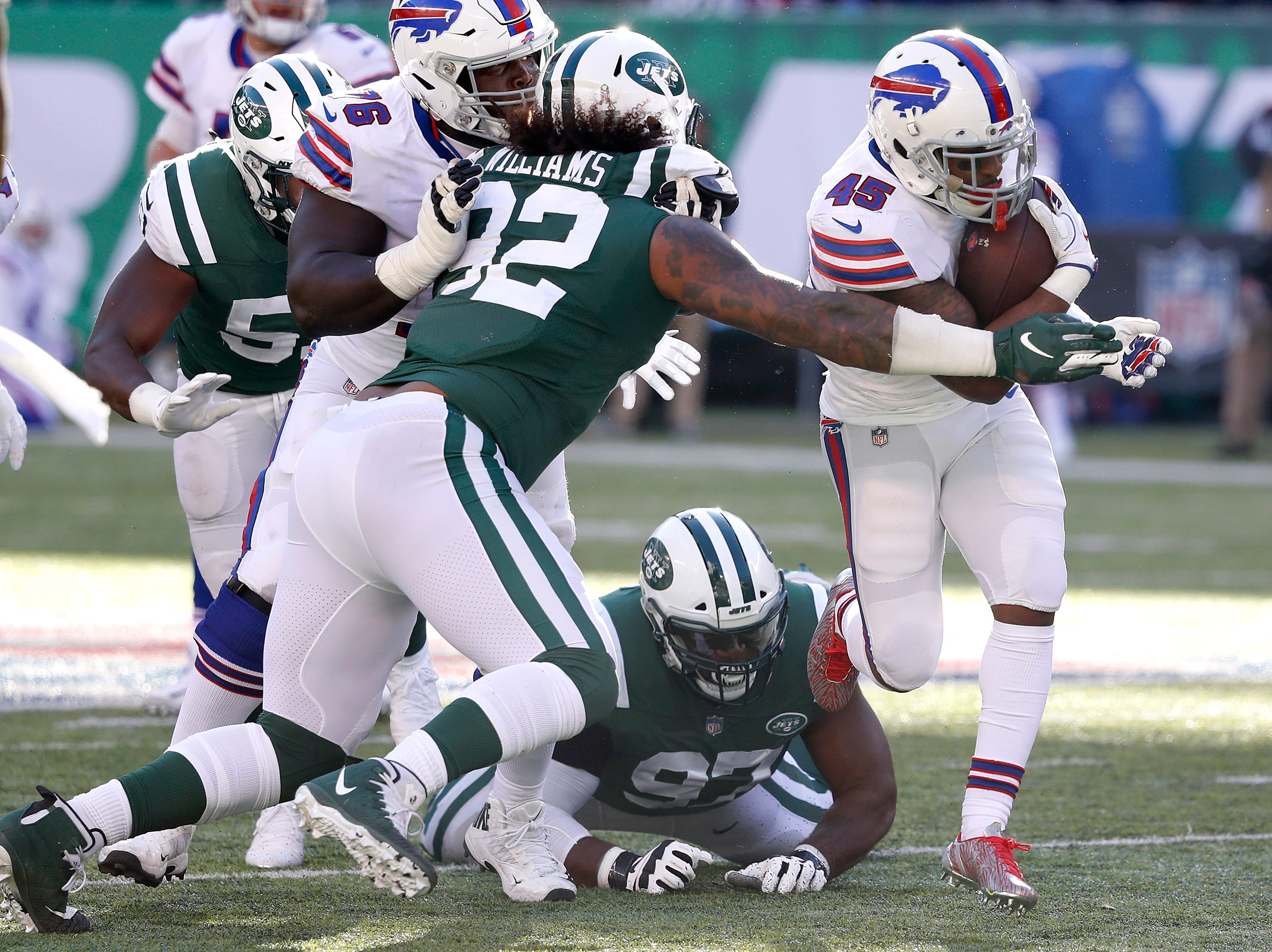 EAST RUTHERFORD, NEW JERSEY - NOVEMBER 11: Marcus Murphy #45 of the Buffalo Bills runs the ball against Leonard Williams #92 of the New York Jets during the second quarter at MetLife Stadium on November 11, 2018 in East Rutherford, New Jersey. (Photo by Michael Owens/Getty Images)