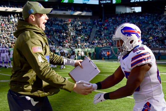 EAST RUTHERFORD, NEW JERSEY - NOVEMBER 11: LeSean McCoy #25 is congratulated by his teammate Josh Allen #17 of the Buffalo Bills after his first quarter touchdown against the New York Jets at MetLife Stadium on November 11, 2018 in East Rutherford, New Jersey. (Photo by Steven Ryan/Getty Images)