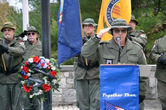 Valentino Gatto, president of Vietnam Veterans of America Chapter 20, salutes during a Veterans Day ceremony at the Vietnam Veterans Memorial at Highland Park on Sunday, Nov. 11, 2018.