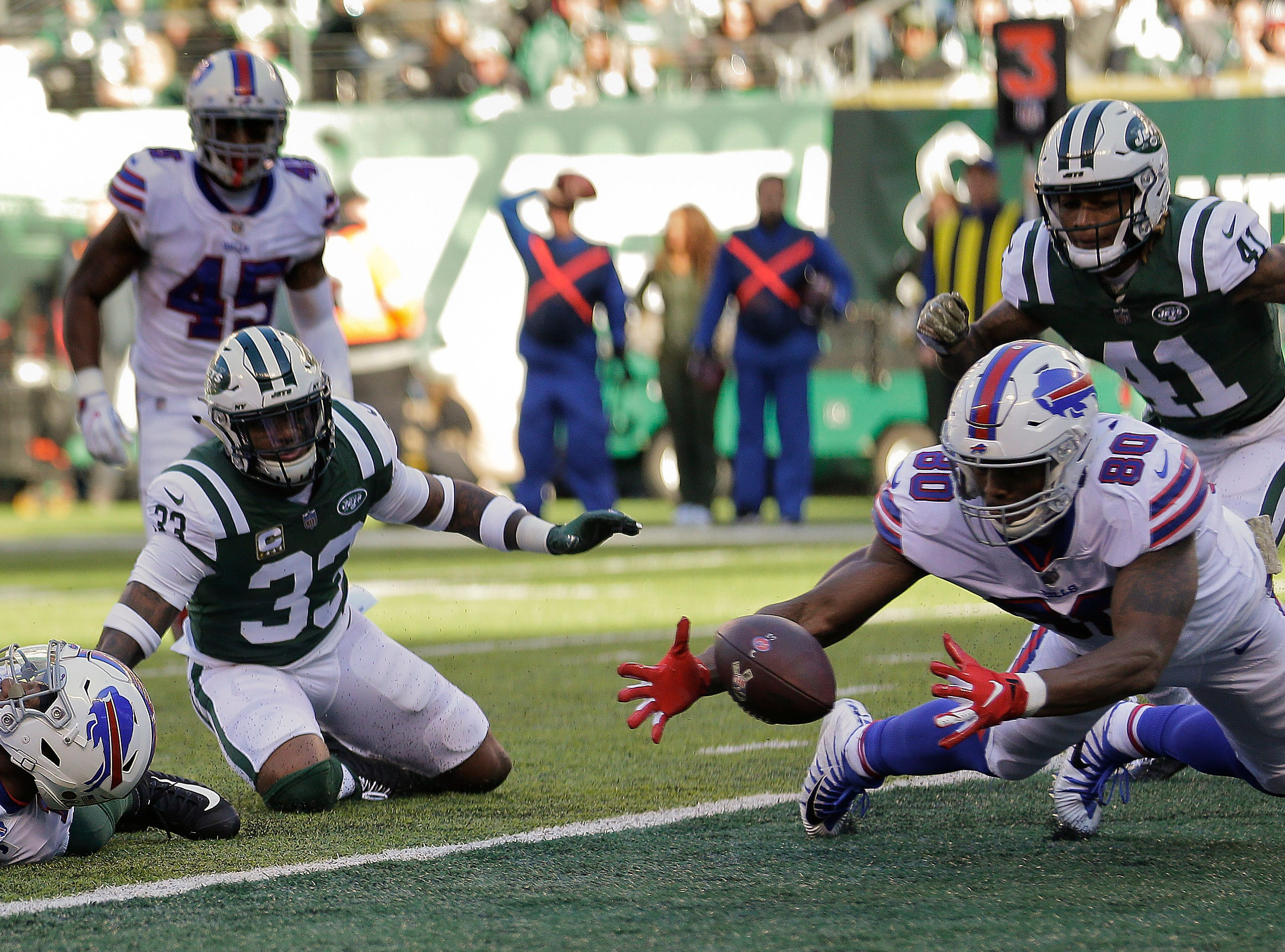 Buffalo Bills tight end Jason Croom (80) recovers a fumble by wide receiver Zay Jones , left, for a touchdown against the New York Jets during the first quarter of an NFL football game, Sunday, Nov. 11, 2018, in East Rutherford, N.J. (AP Photo/Seth Wenig)